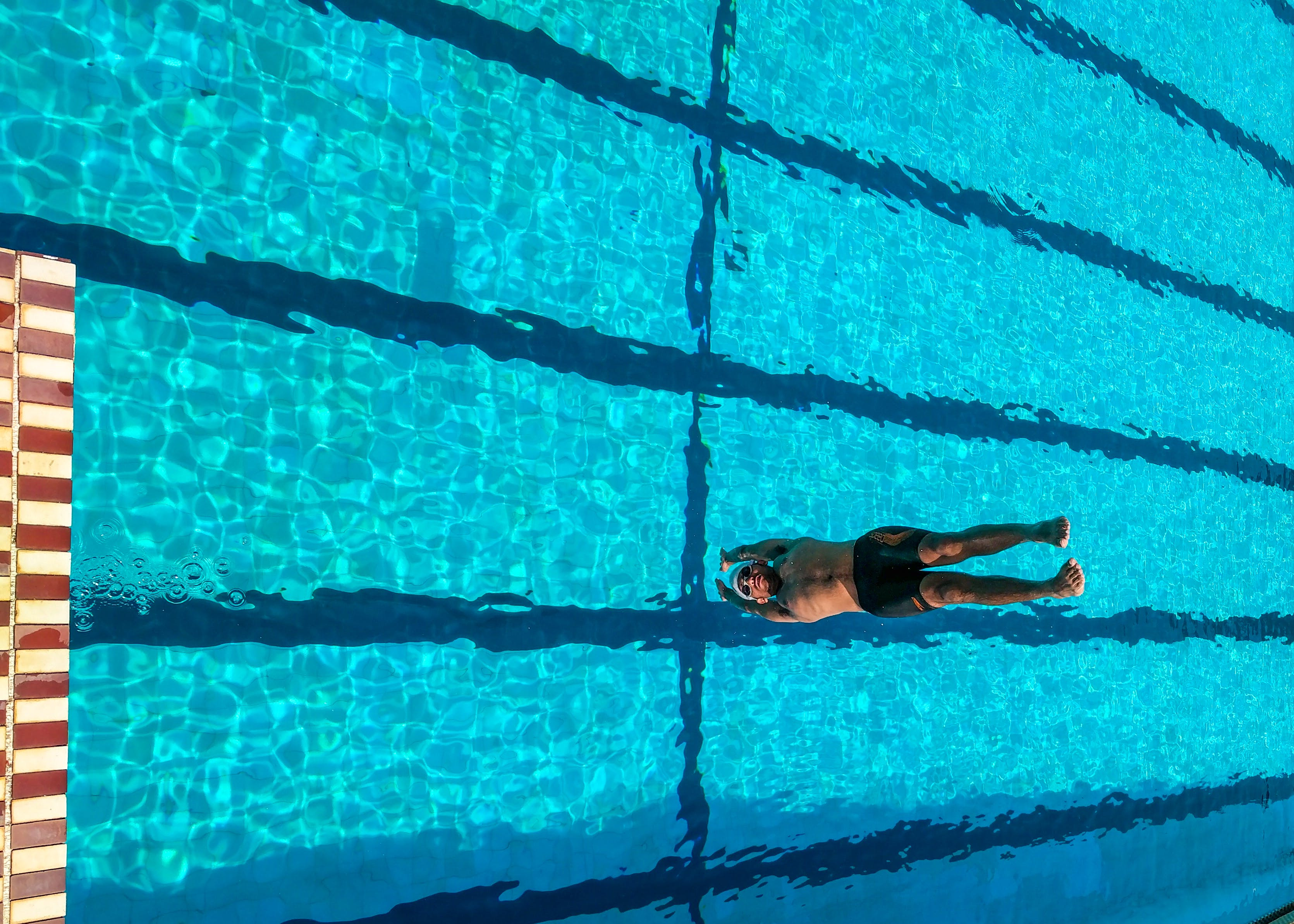 Person Diving on Swimming Pool