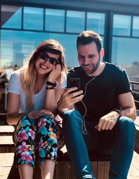 Man and Woman Using an Earphones