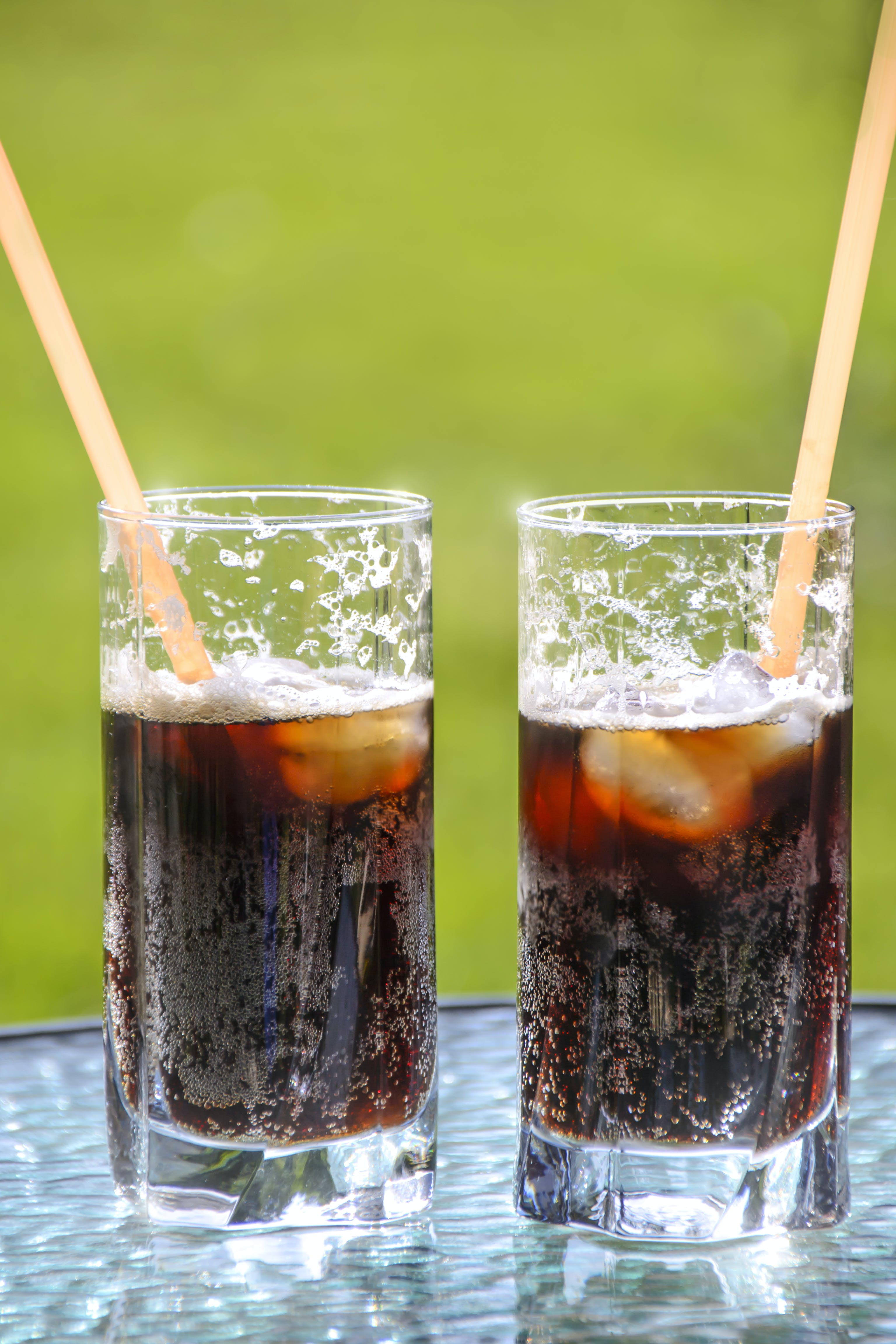 Two Glasses With Beverage and Straws