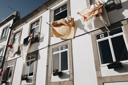 Clothes Hanged on Wire Beside House