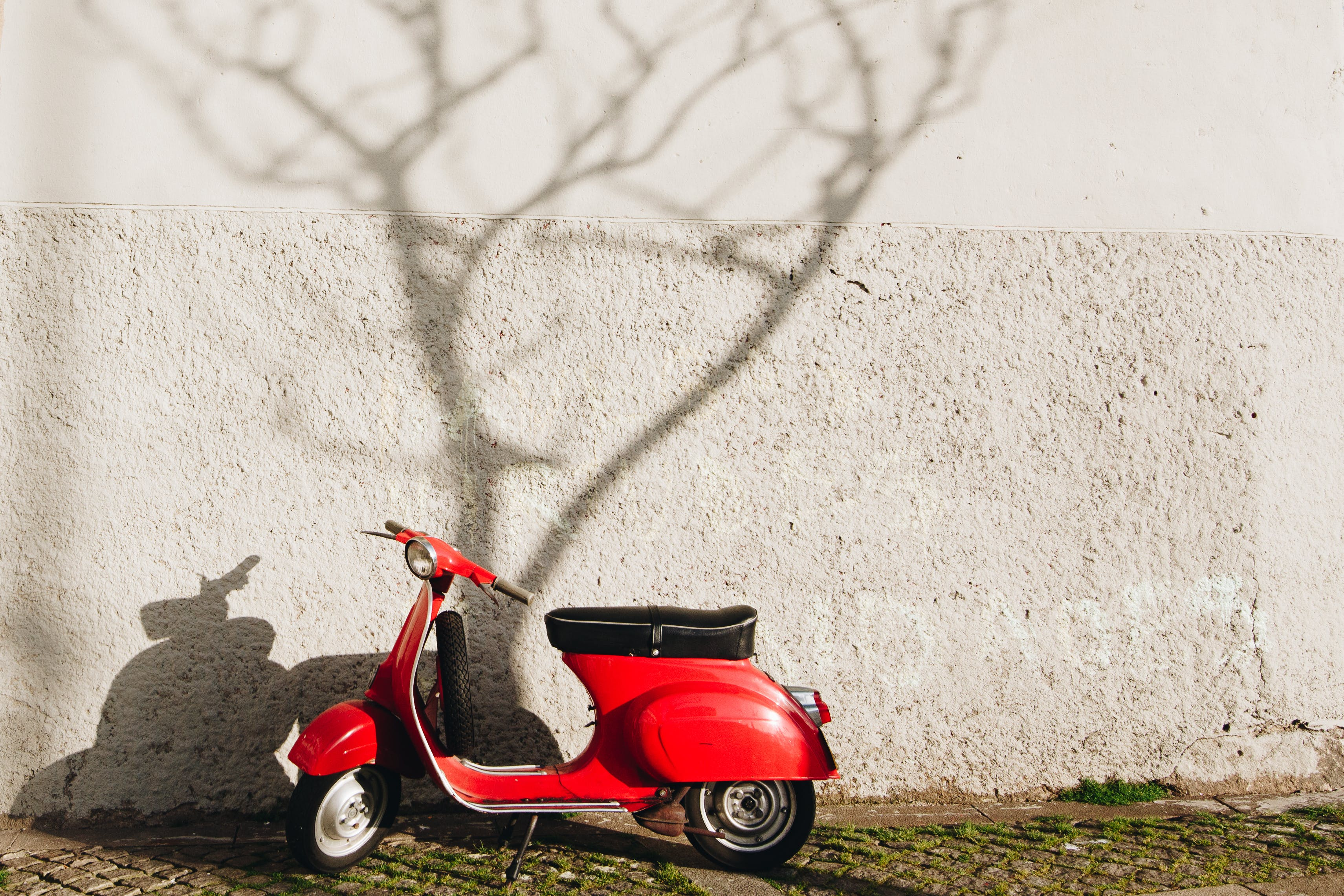 Red Motor Scooter Near Wall