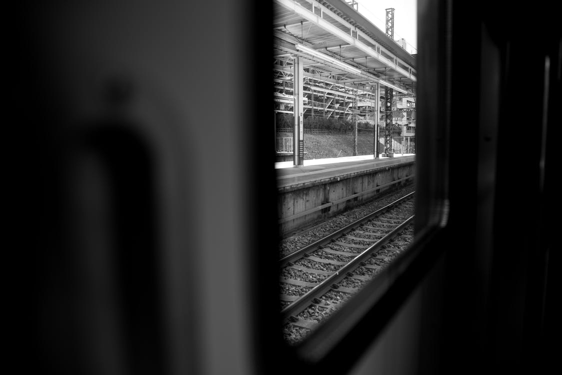 Grayscale Photography of Train Rails