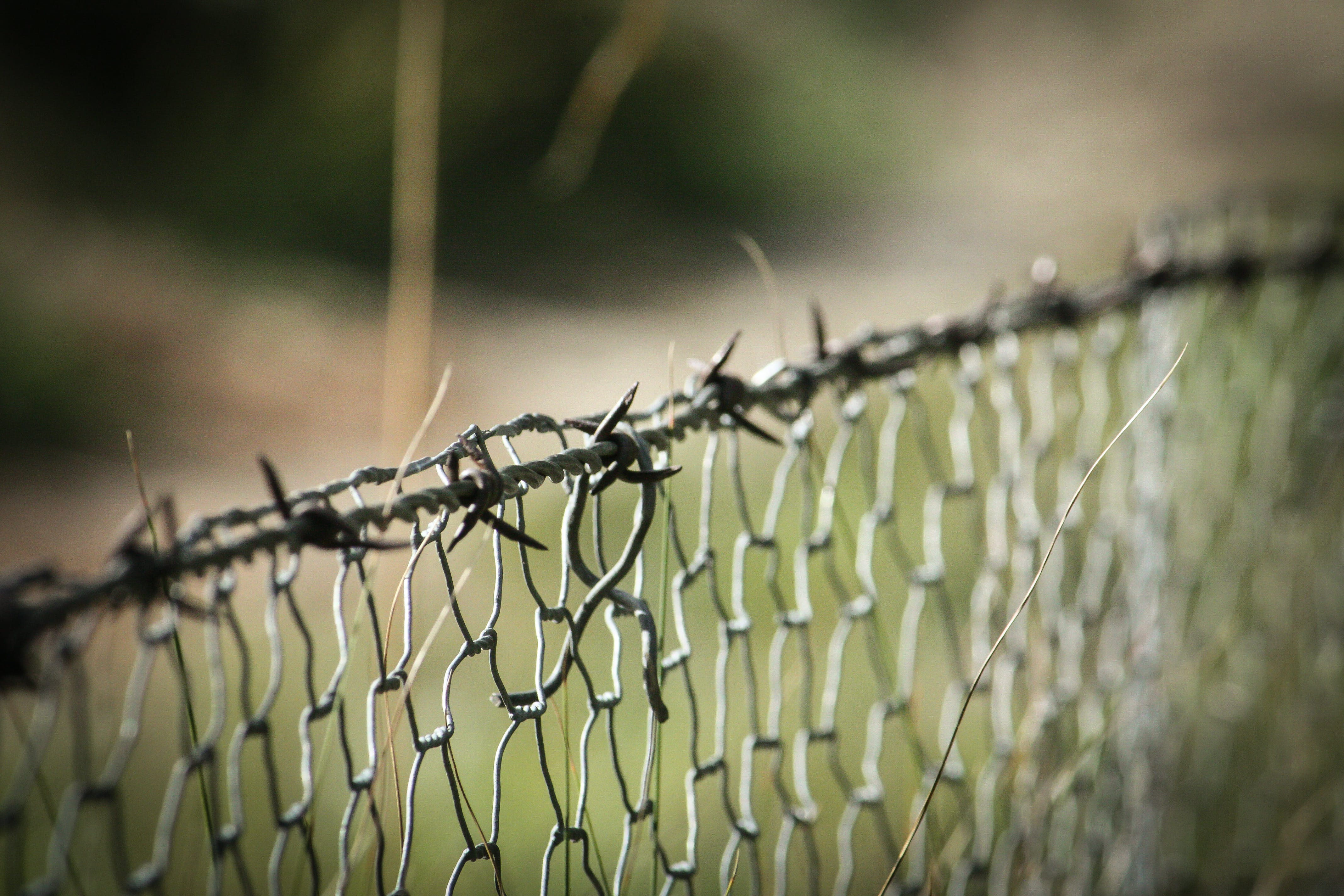 Barbwire on Top of Cyclone Fence