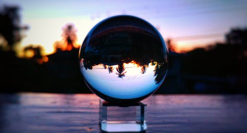 Selective Focus Photo of Clear Glass Ball