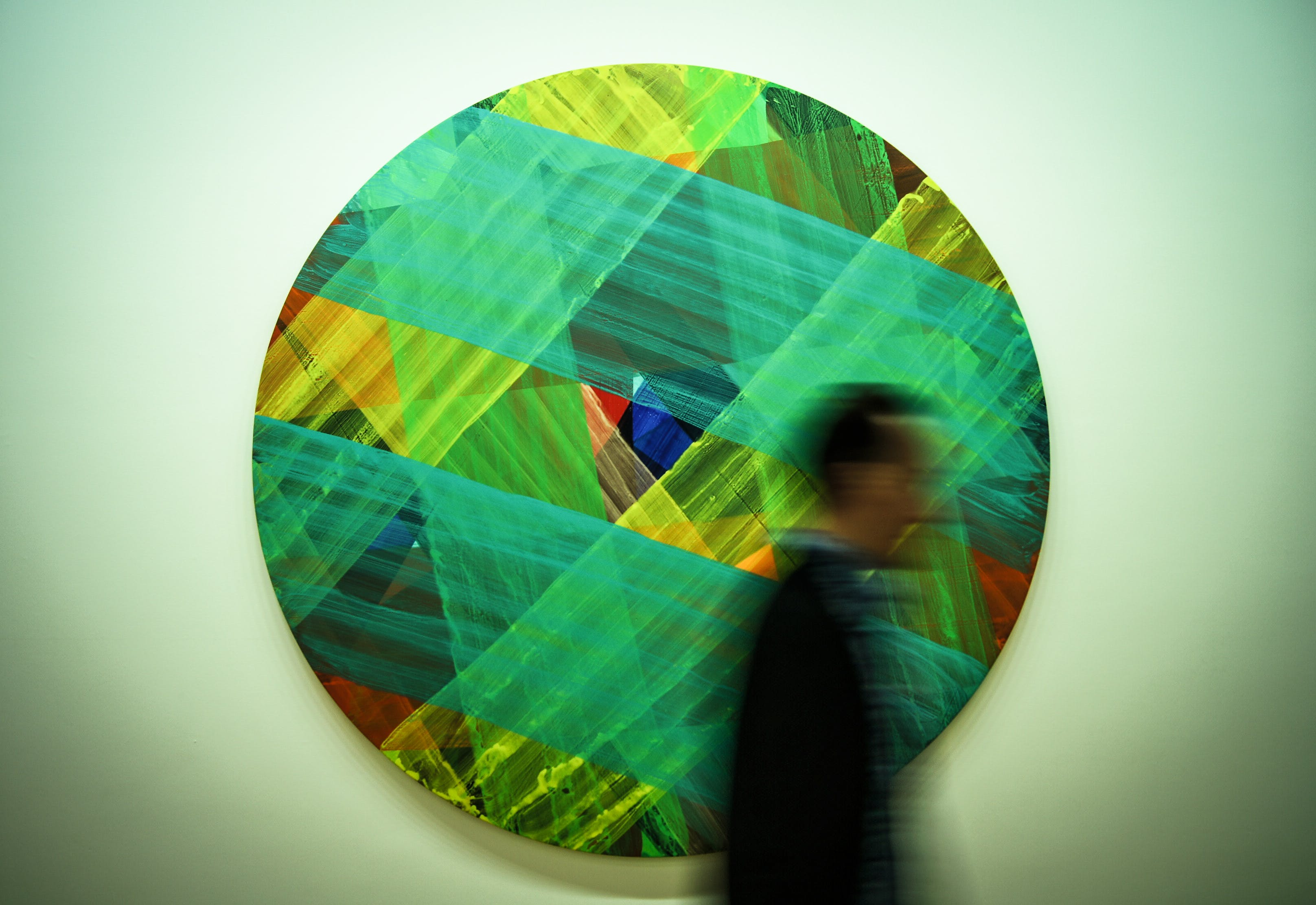 Man Passing by Multicolored Art