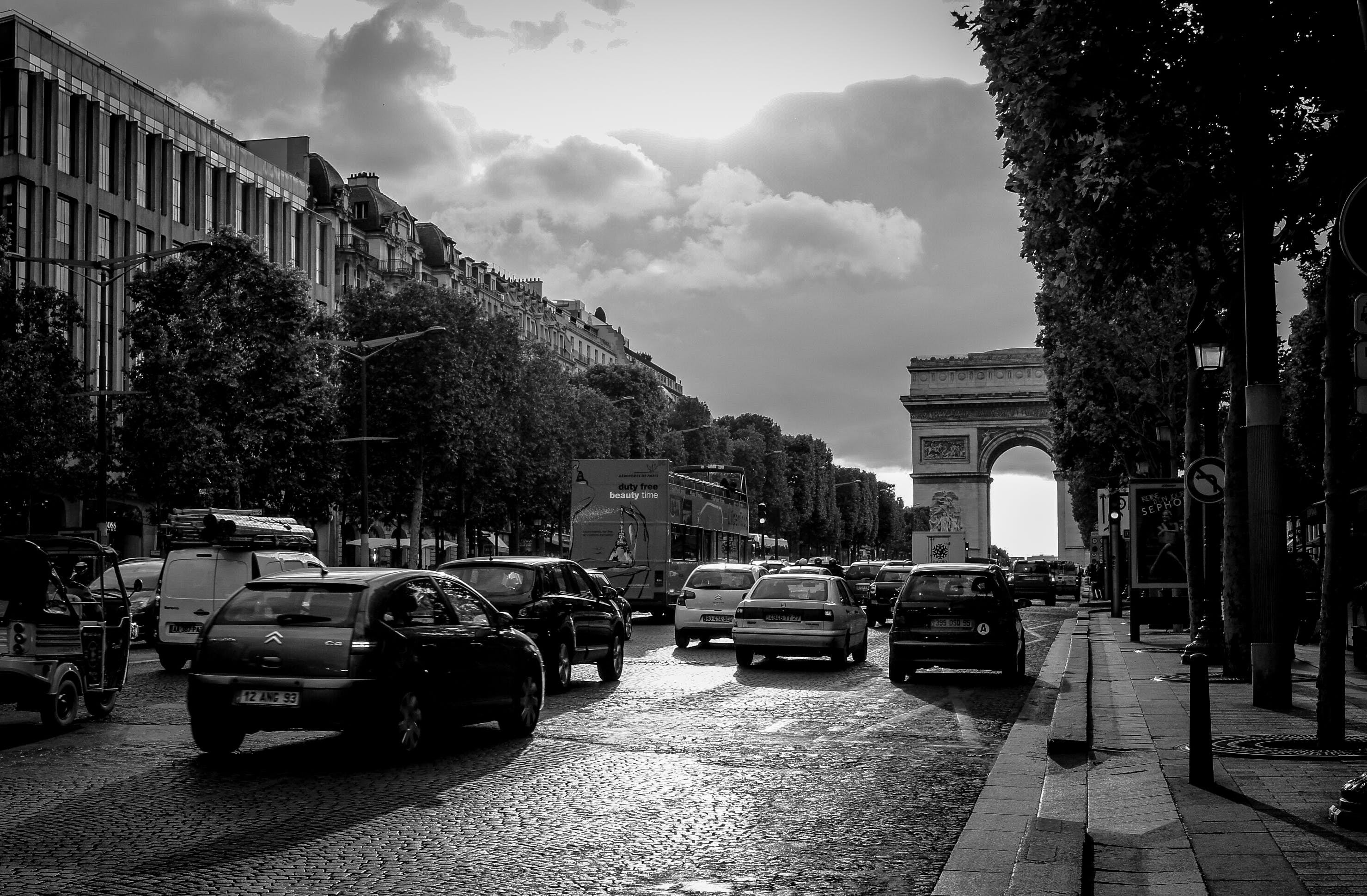 Grayscale Photo of Busy Streets With Building