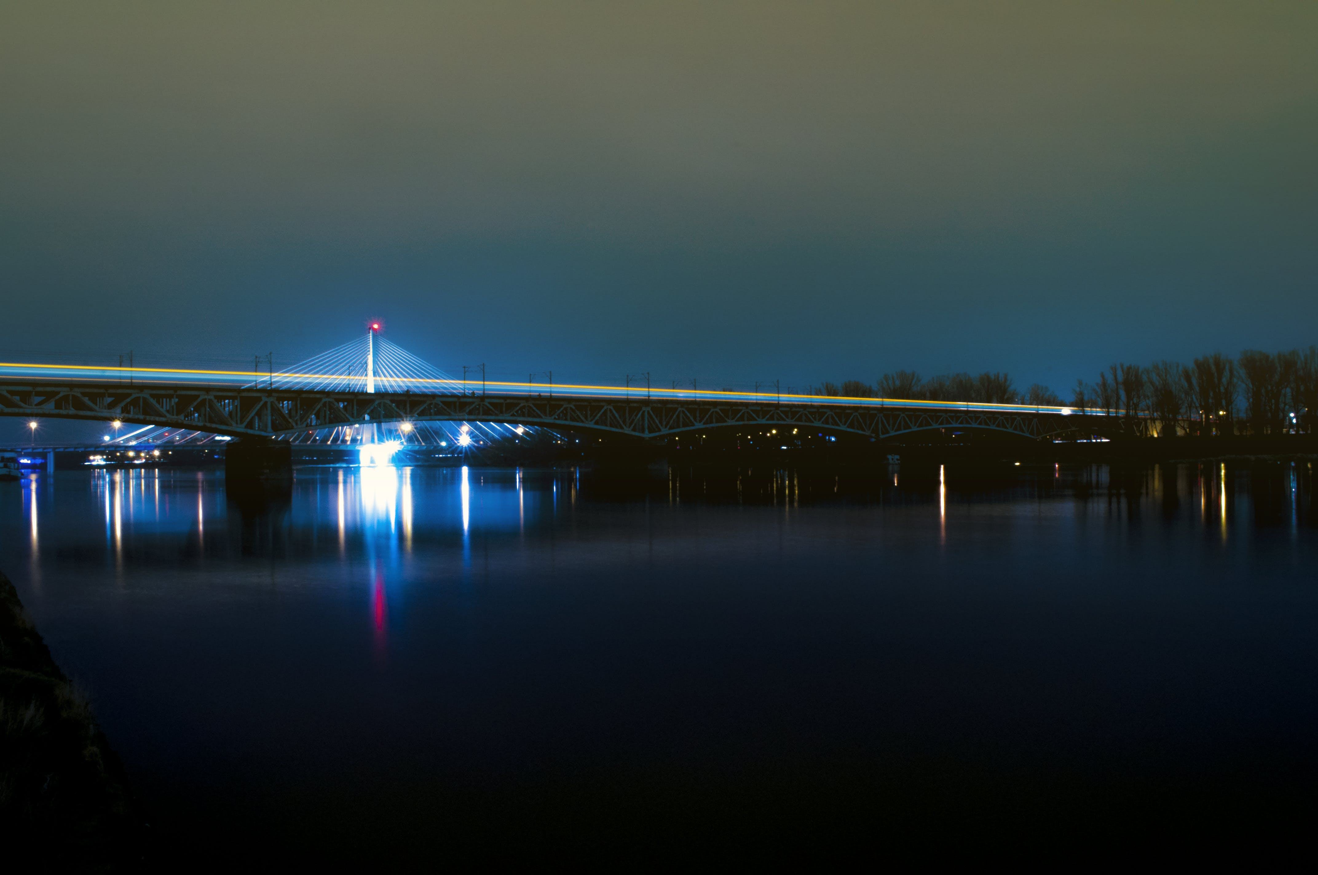 Body of Water With Bridge at Night
