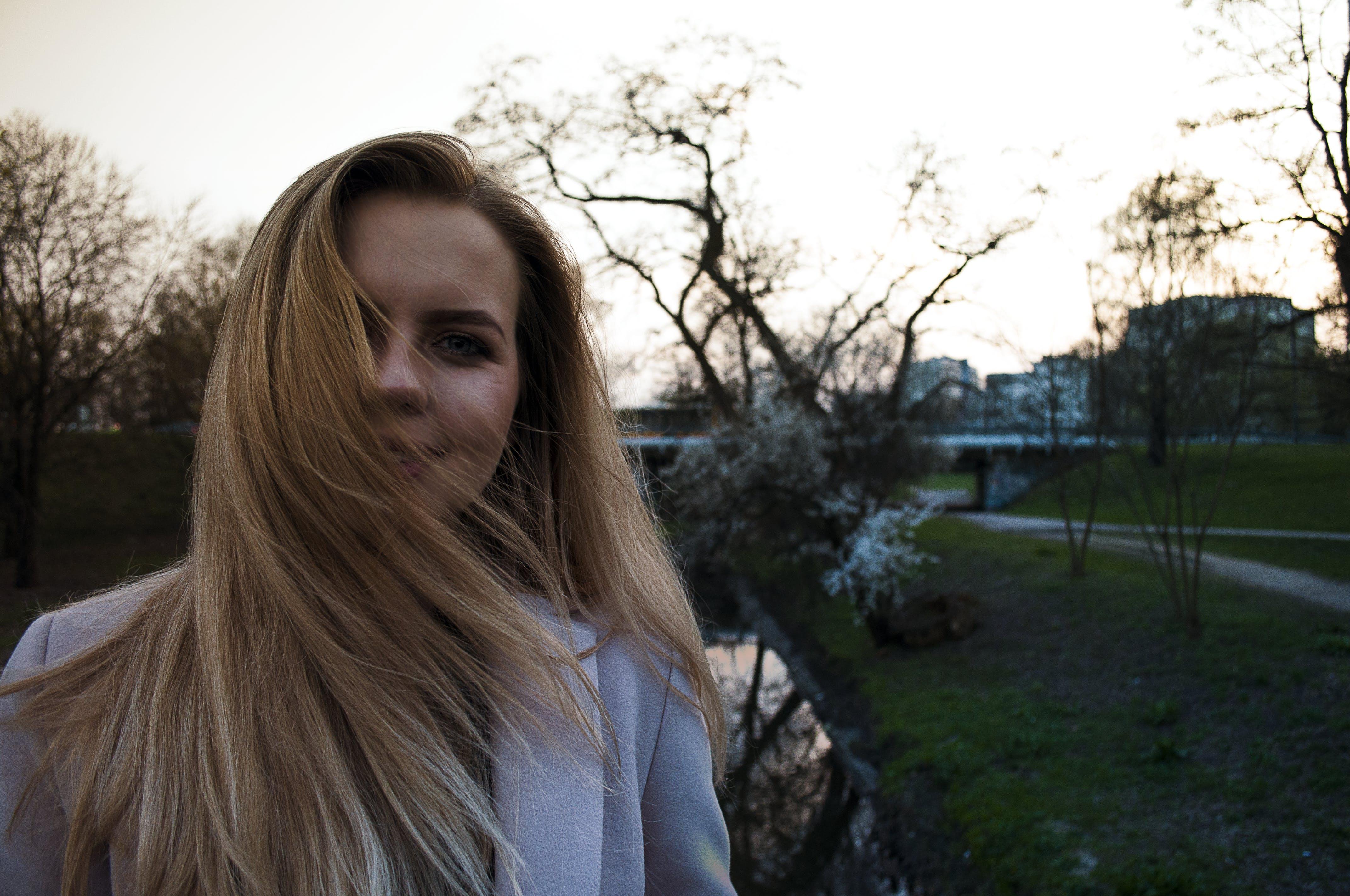 Woman Wearing White Winter Coat While Taking Selfie