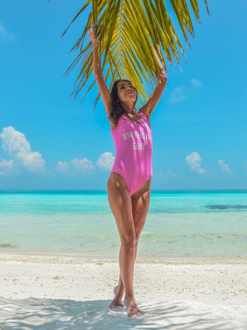 Woman Wearing Pink Swimsuit Beside Seashore