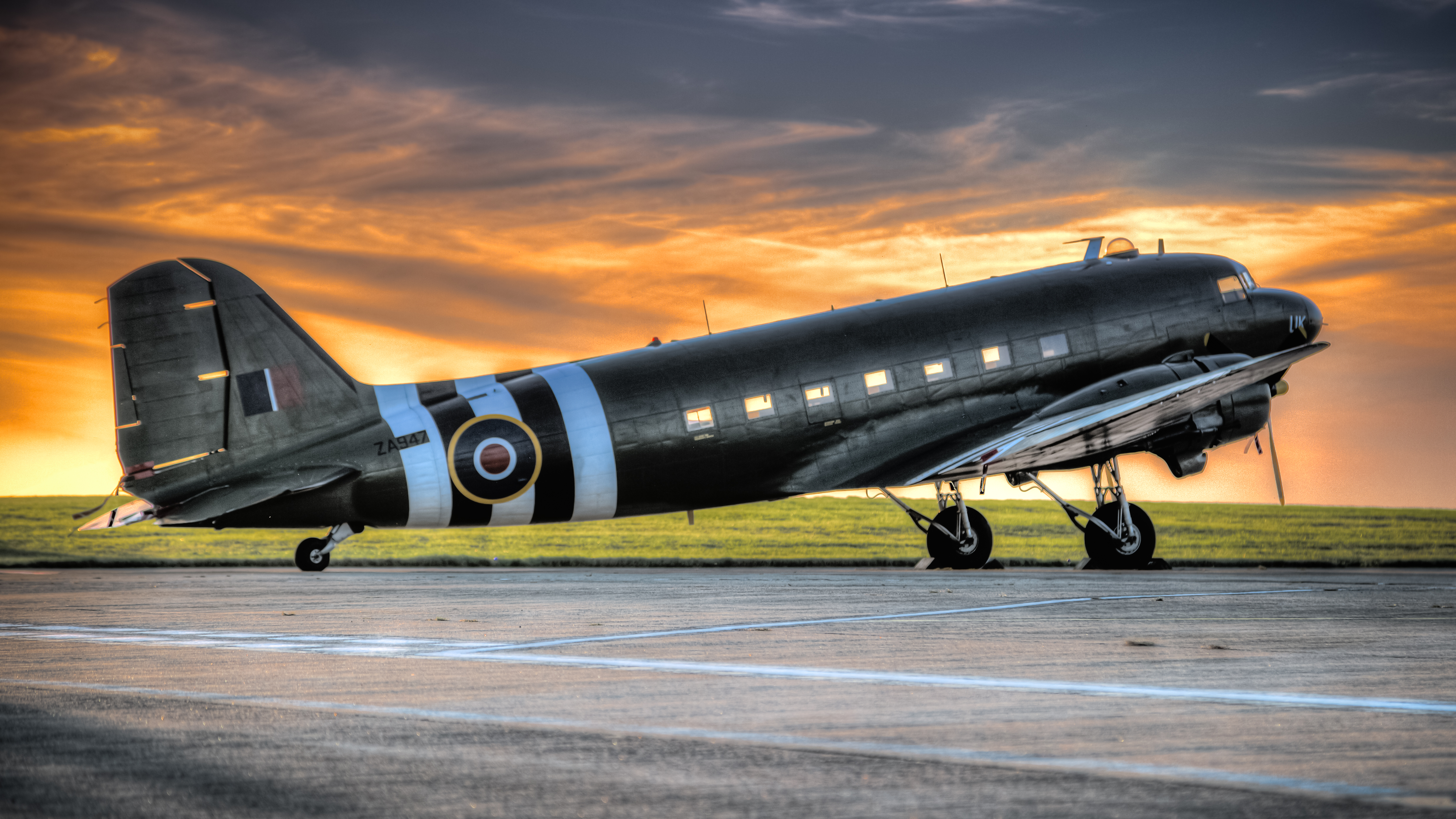 Photo of Black and White Airplane during Golden Hour