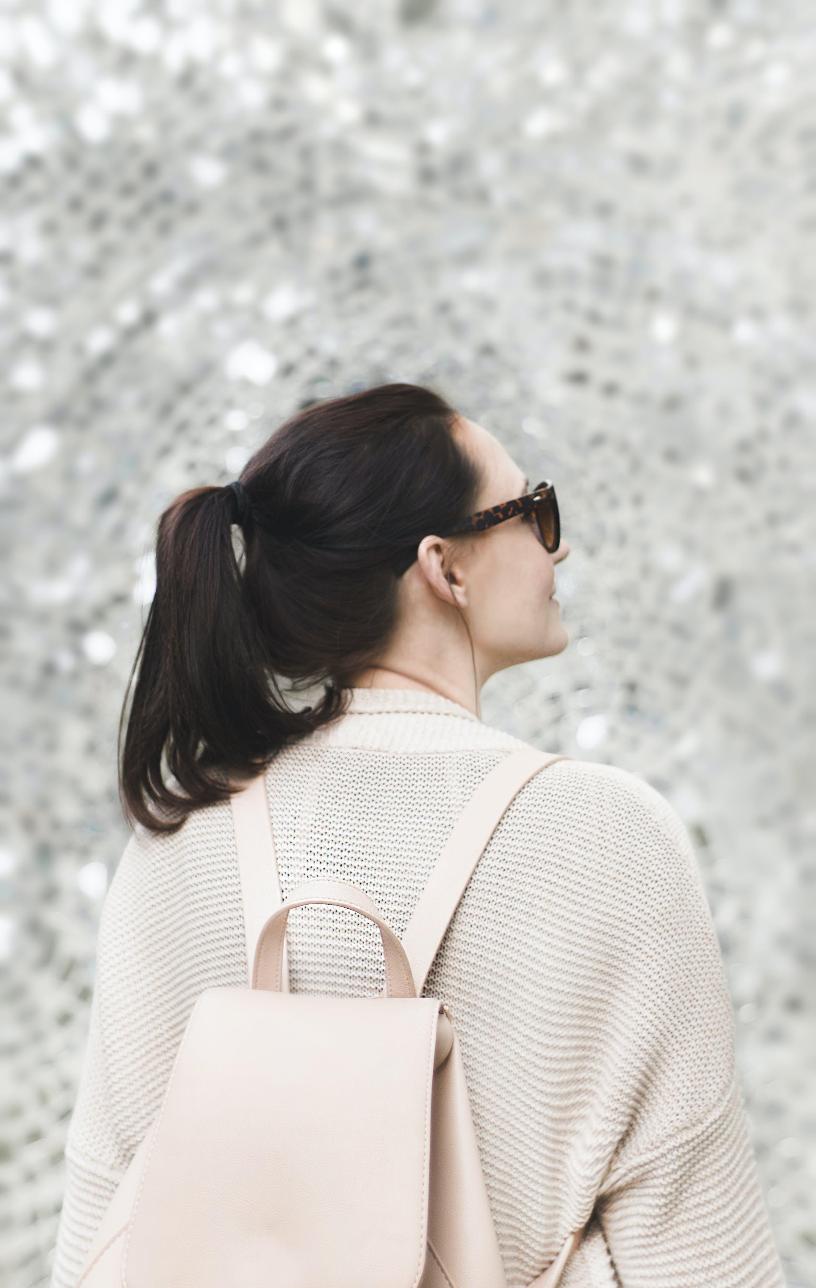 Woman Wearing White Sweatshirt and Backpack
