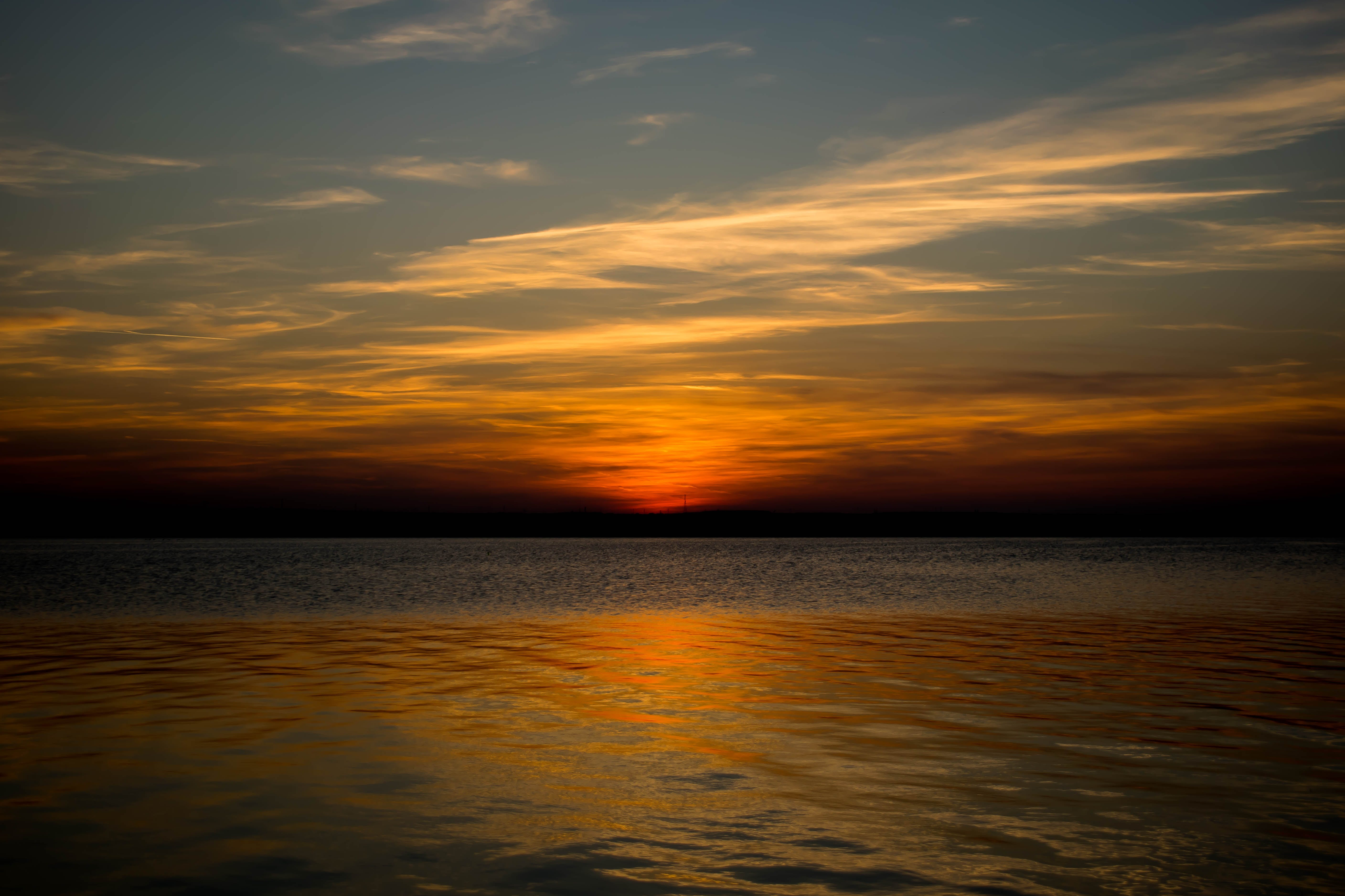 Photograph of Body of Water during Sunset