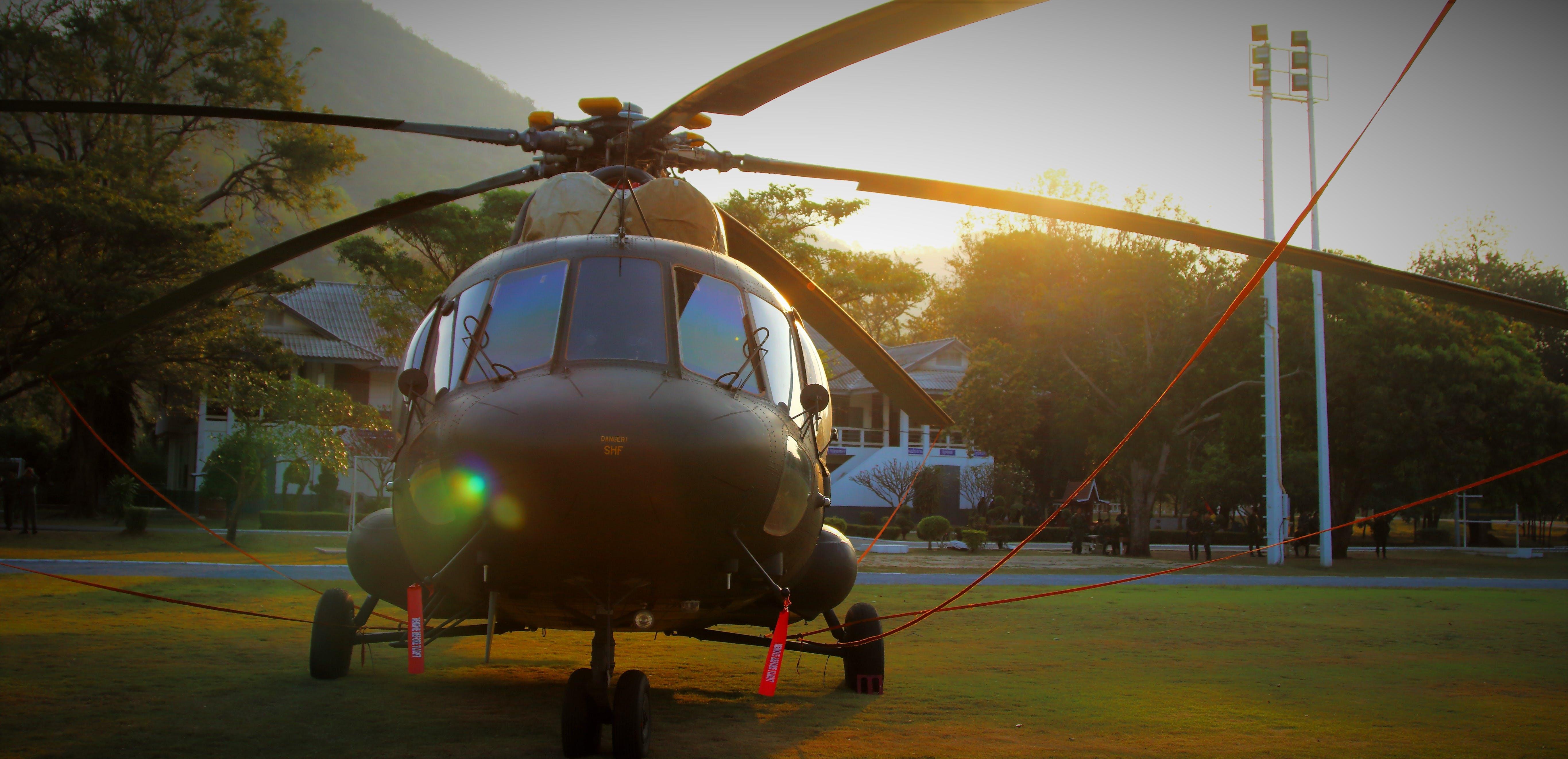 Black Chopper on Green Grass Lawn during Daytime