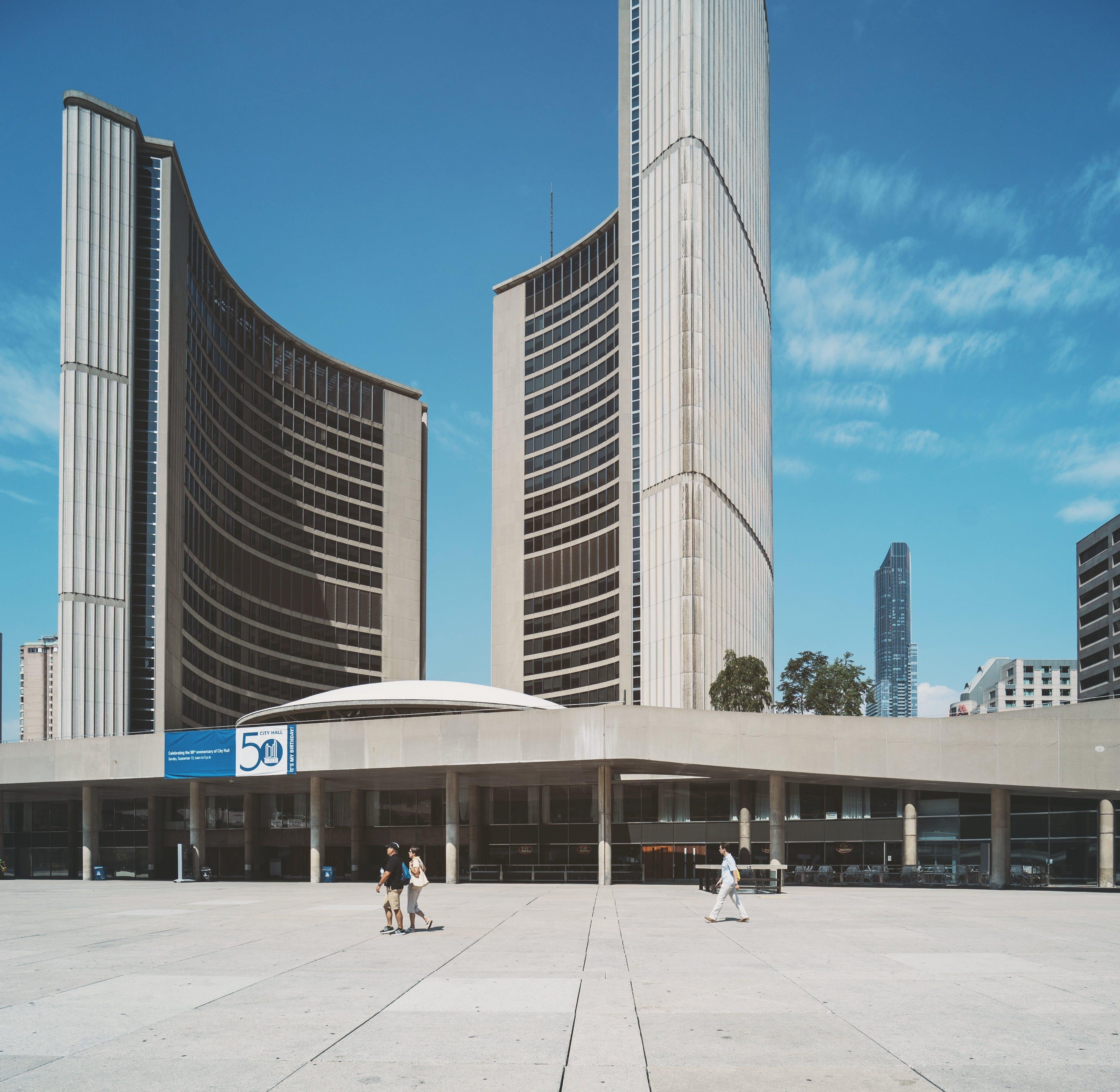 People Walking Near Grey High-rise Building
