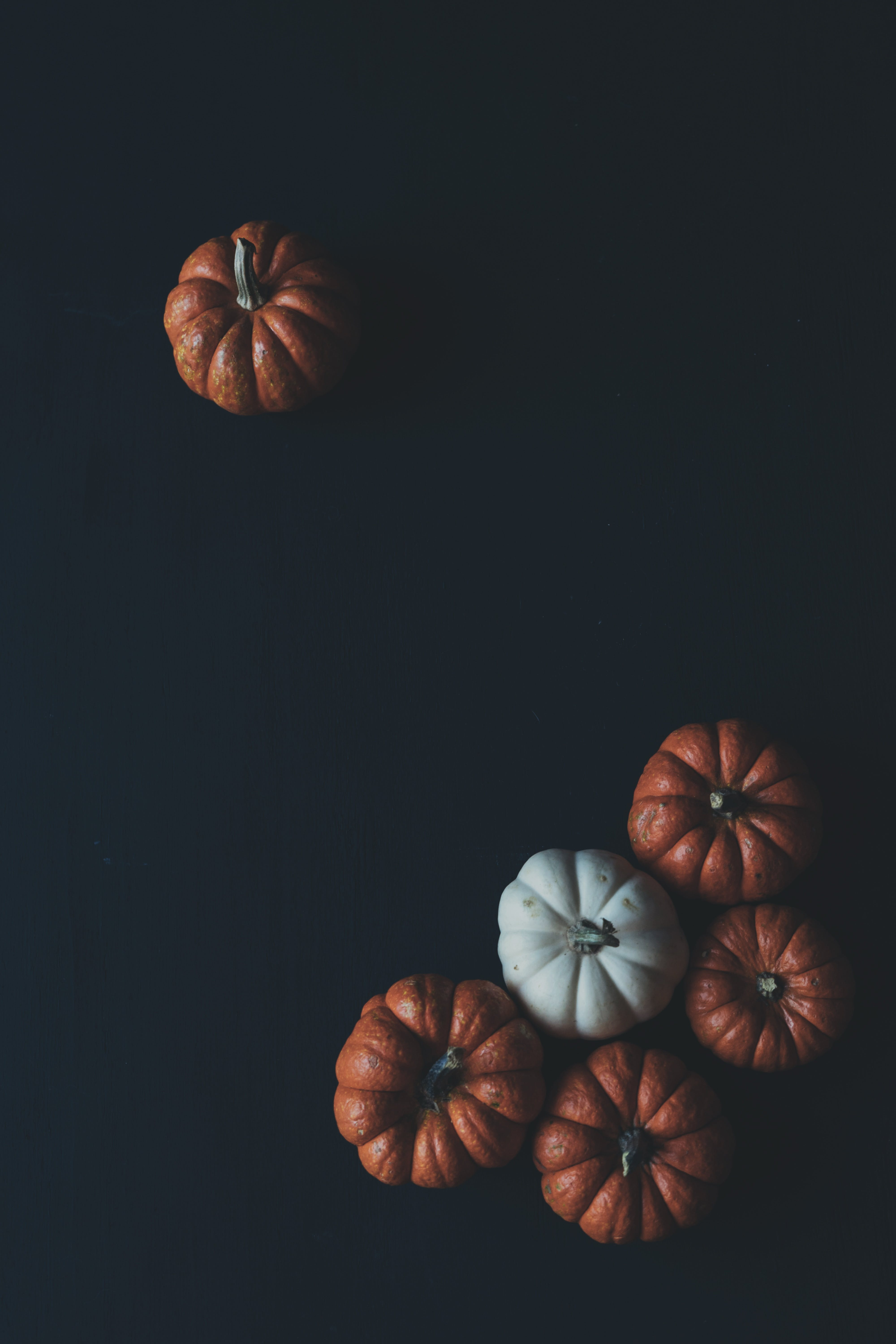 One and Five Brown Pumpkins