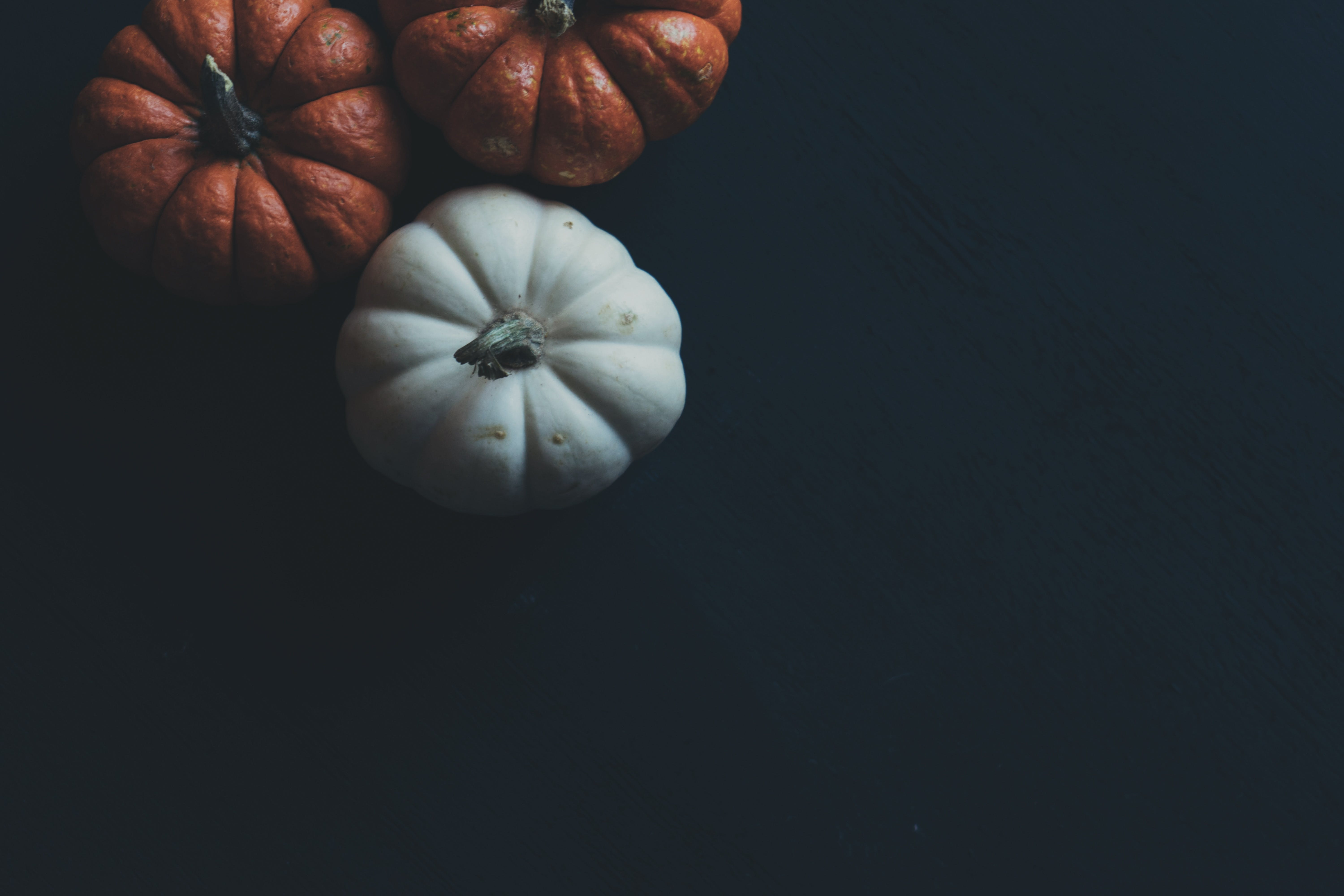Three Orange and White Pumpkins