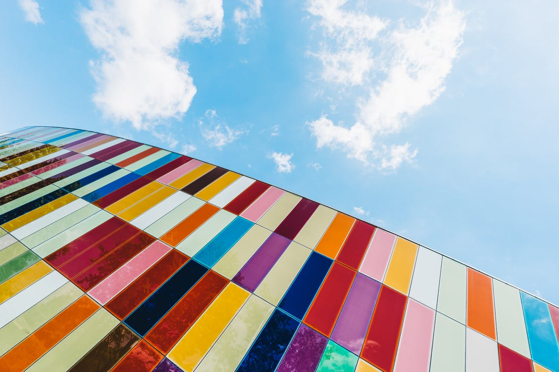 Low Angle of Colorful Glass Panels Under Blue Sky