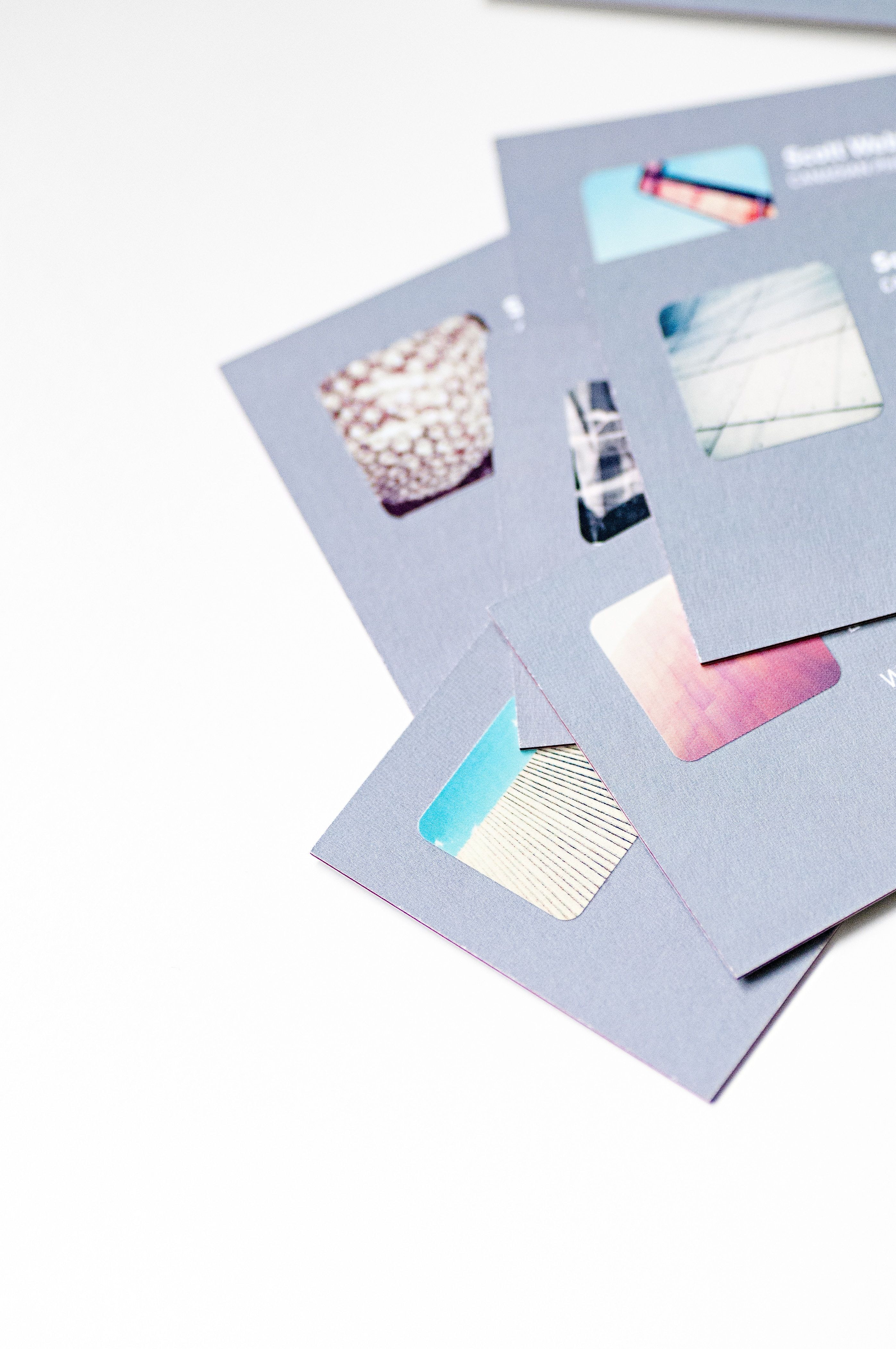 Photo of Gray Cards on White Surfafce