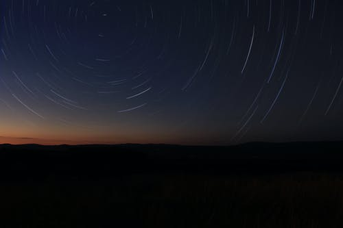 Time-lapse Photography of Stars in Sky at Night