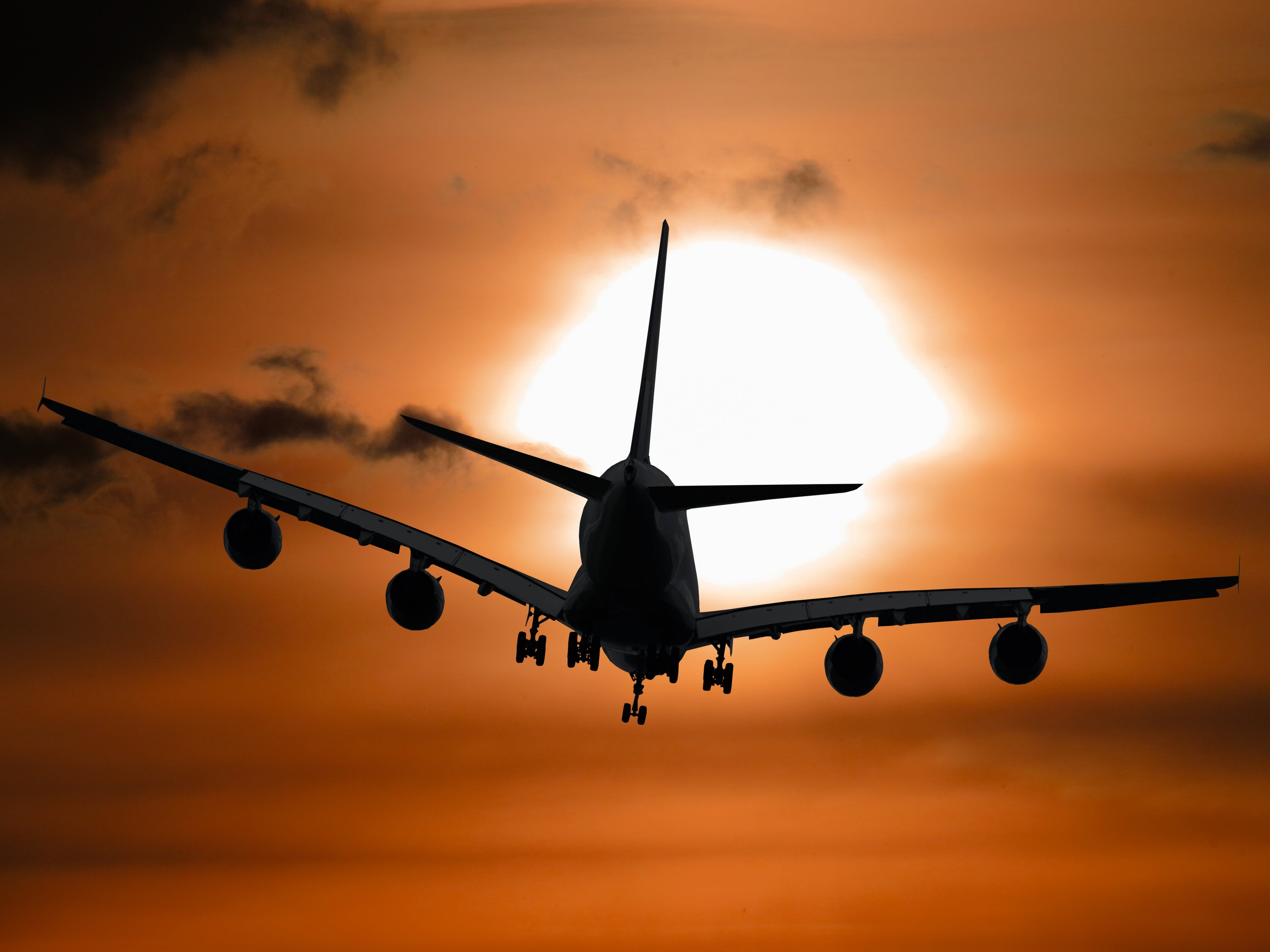 Shadow Image of a Plane Flying during Sunset