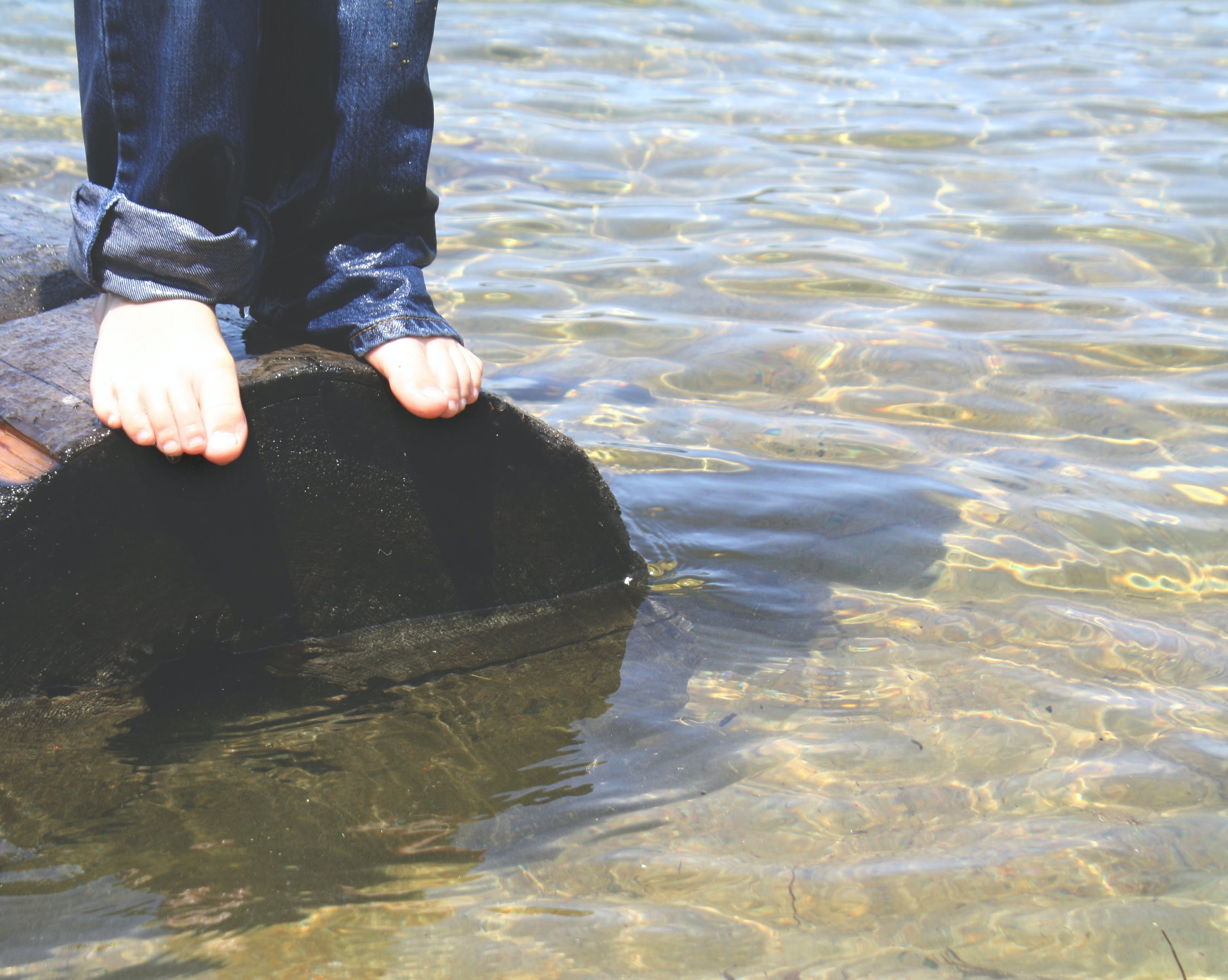 Free stock photo of jeans, lake, log, toes