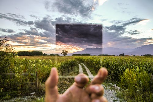 Free stock photo of cokin filter, field, glass, hand