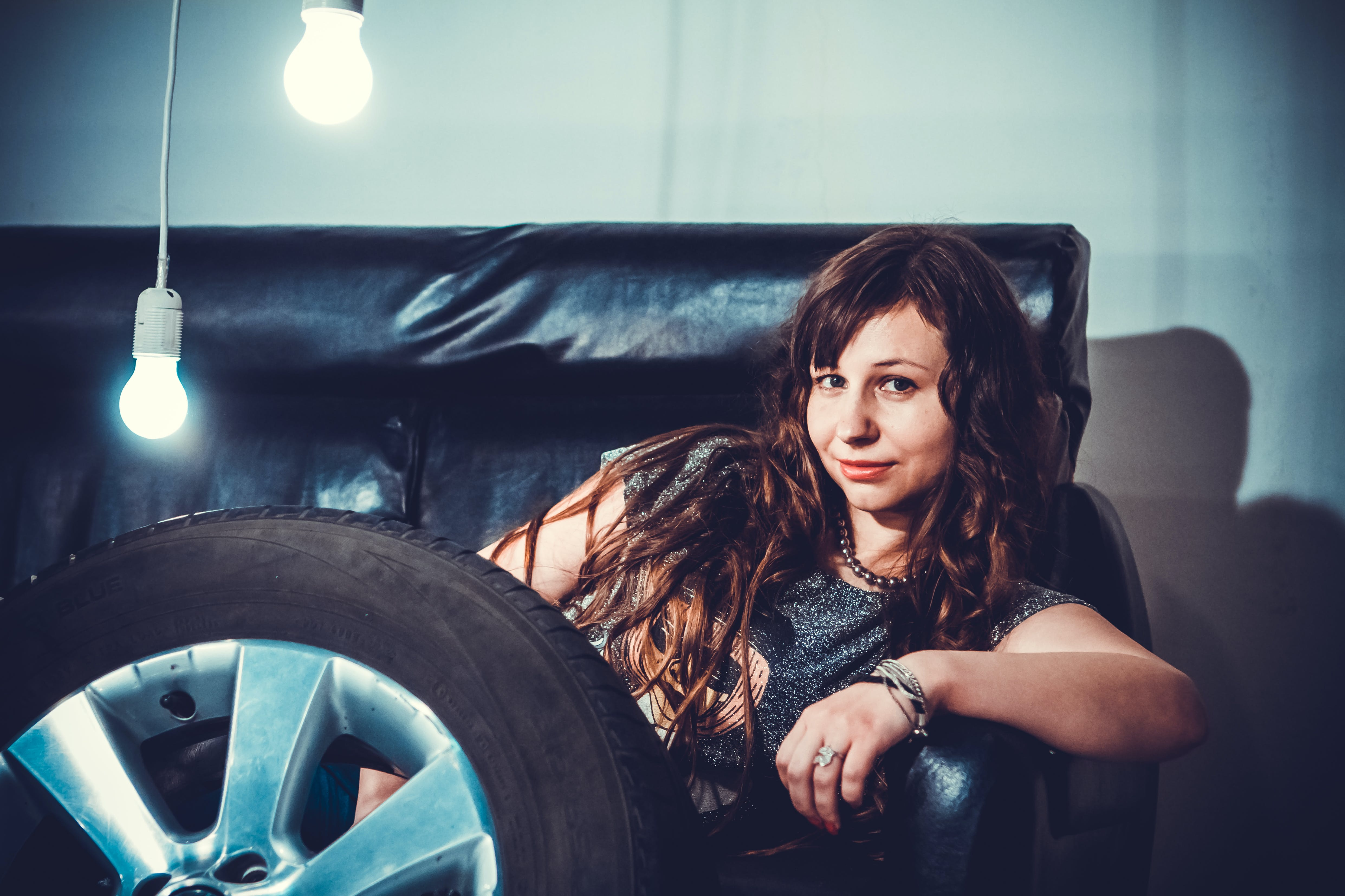 Photo of Woman Sitting on Couch Front of Wheel
