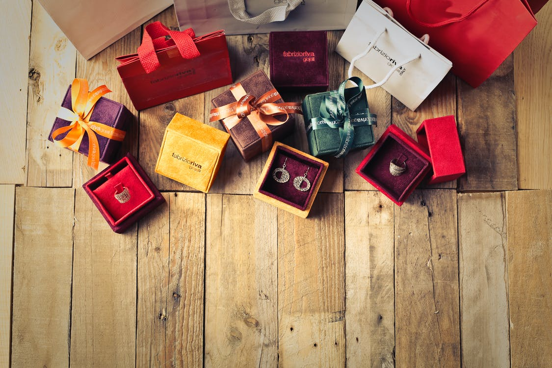 Assorted Gift Boxes on Brown Wooden Floor Surface