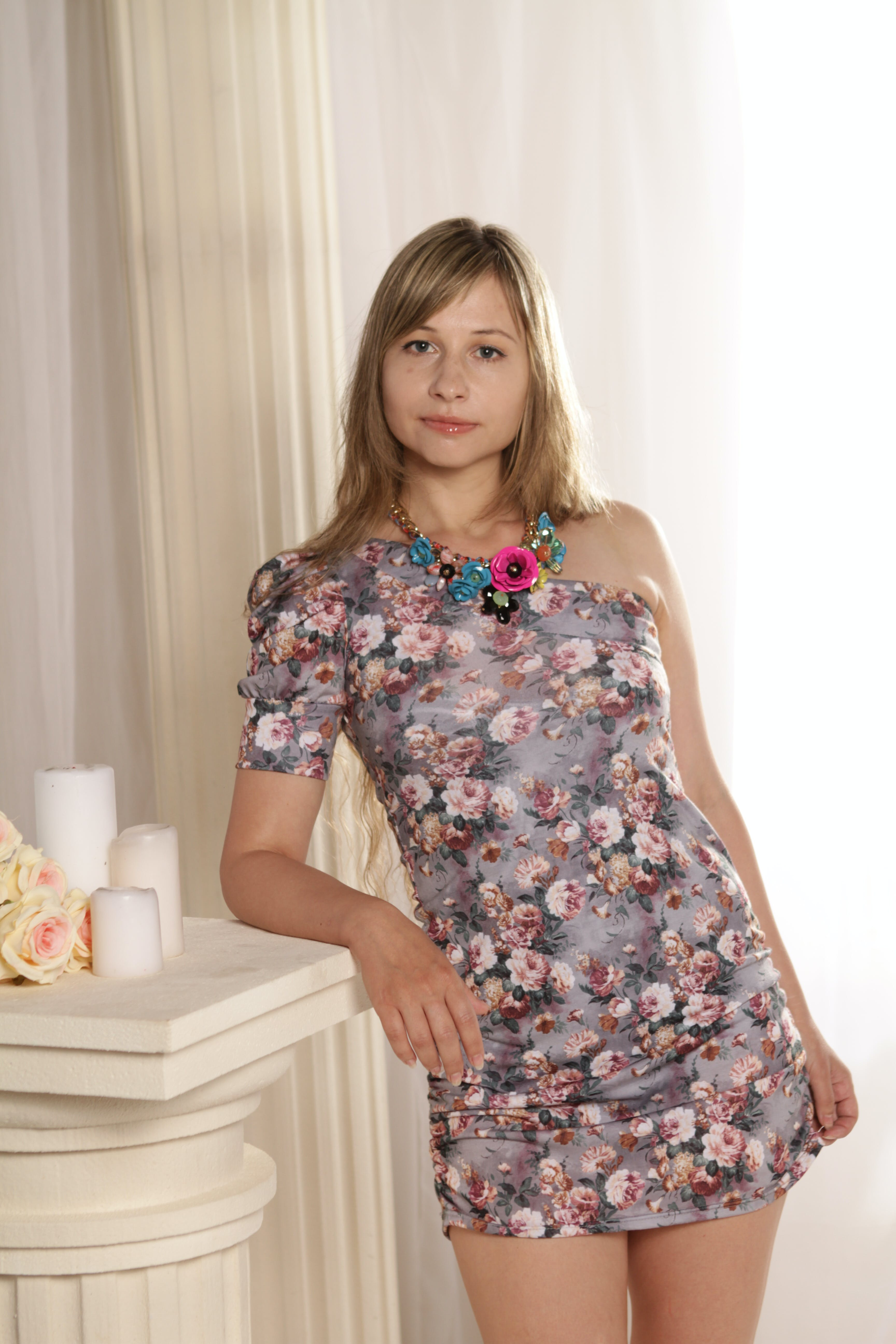 Woman Wearing Gray and Peach Floral One-shoulder Dress