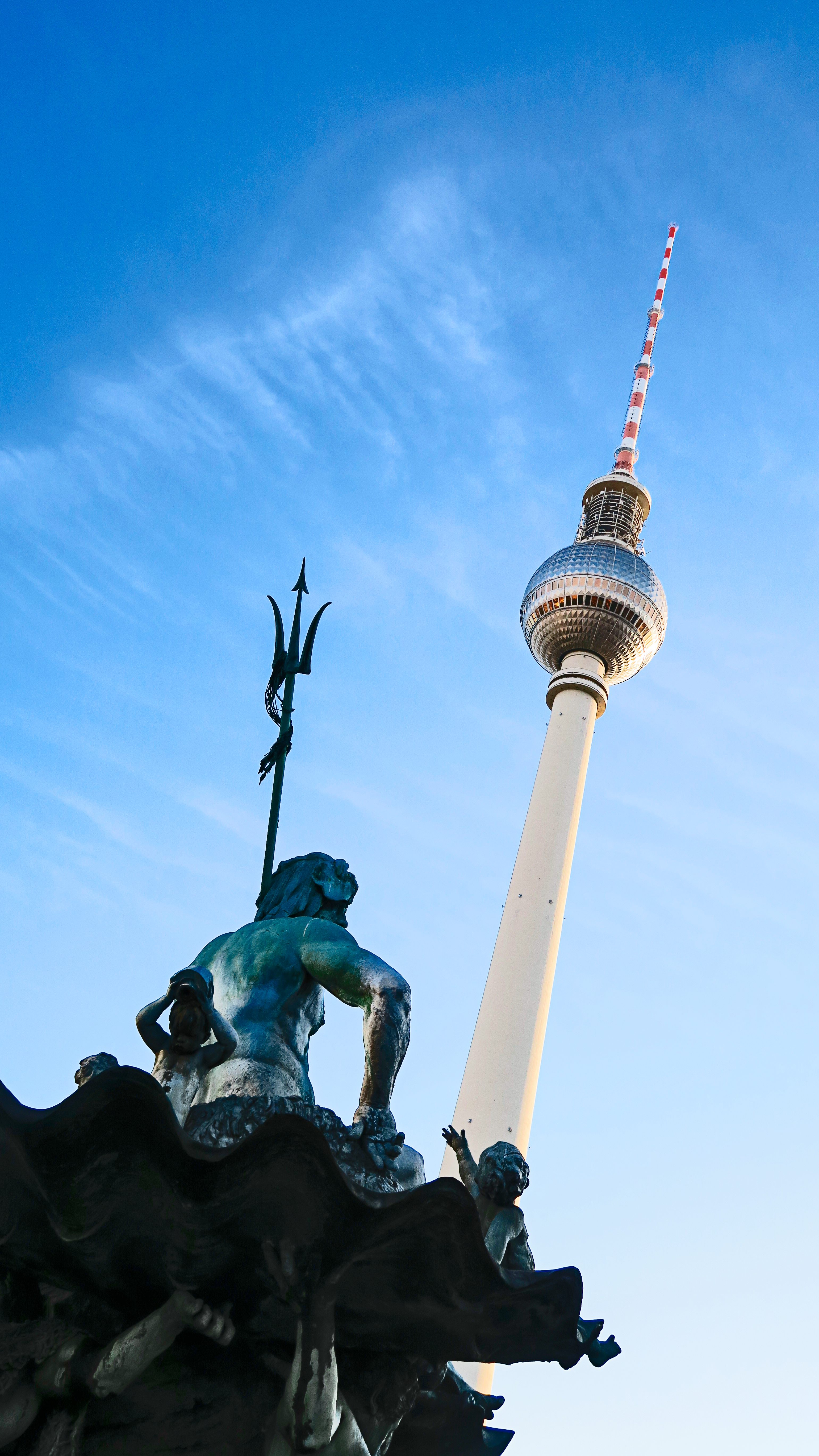 Low Angle Photo of Statue and Tower Structure