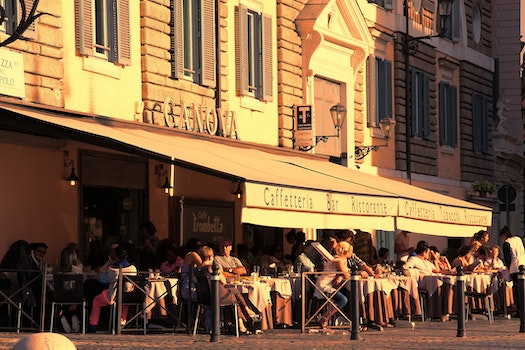 People Sitting Outside Caffetteria during Daytime