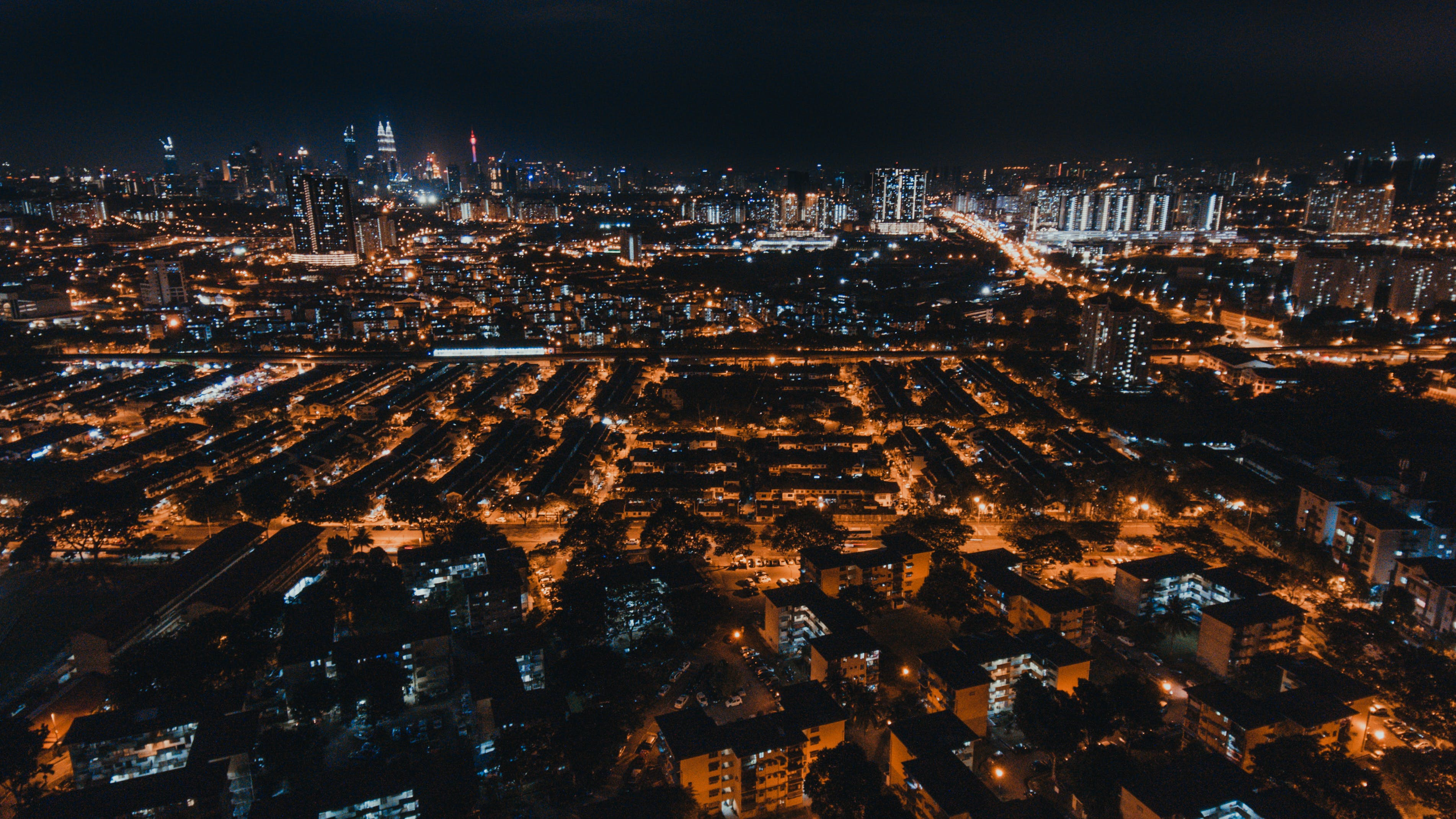 Aerial Photo of City Buildings during Night Time