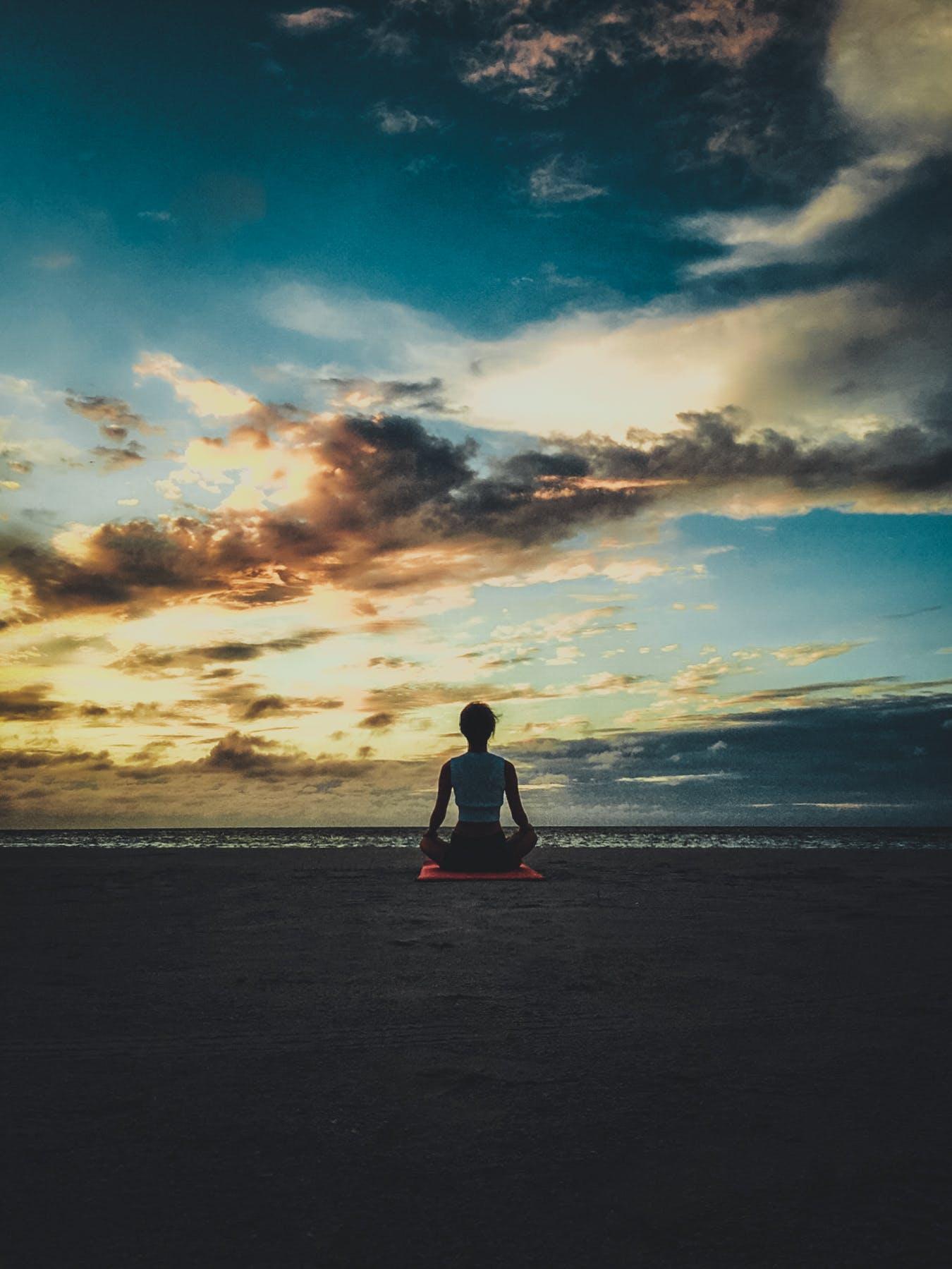Photo of Woman Sitting on Yoga Mat
