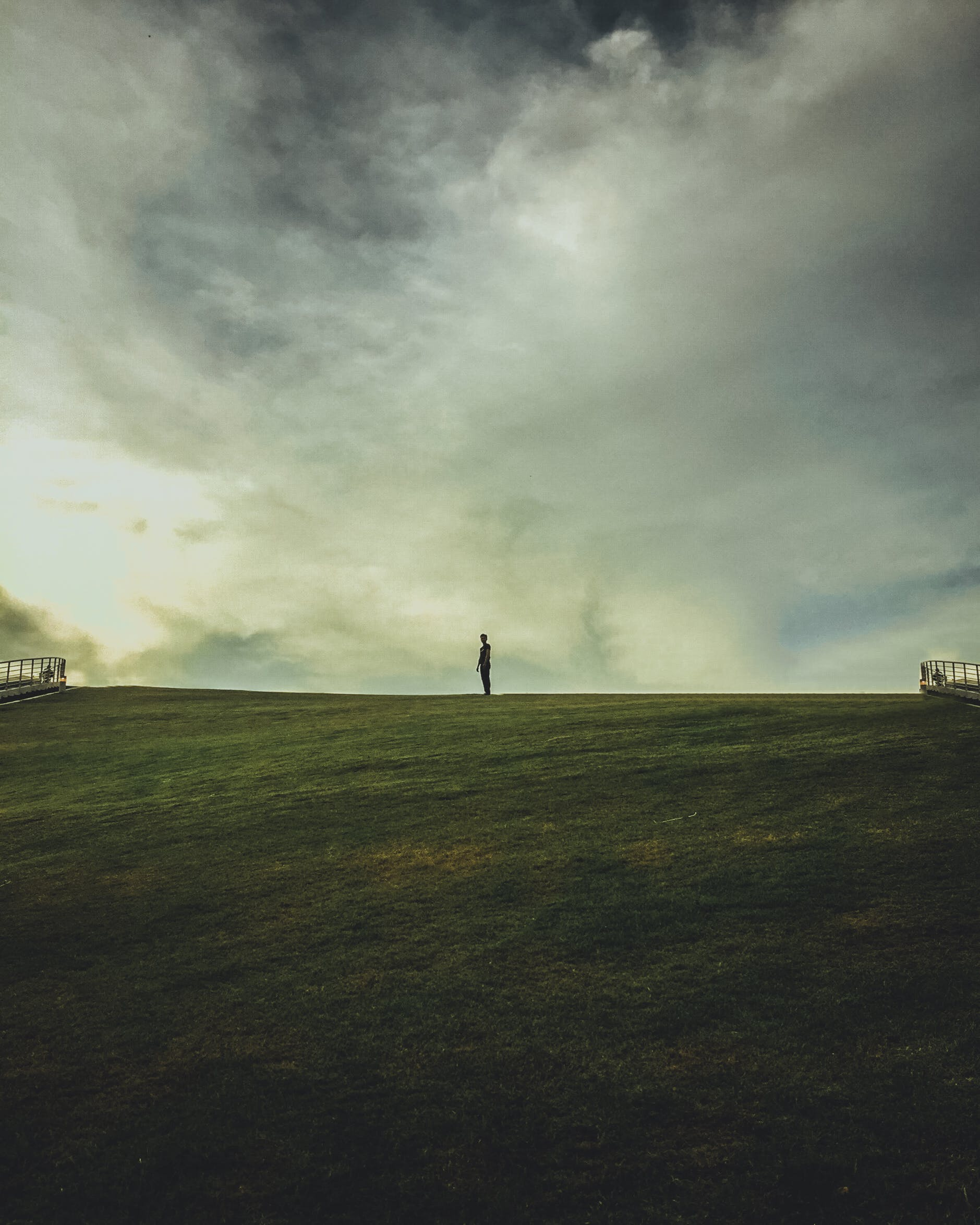 Person on Green Grass Field