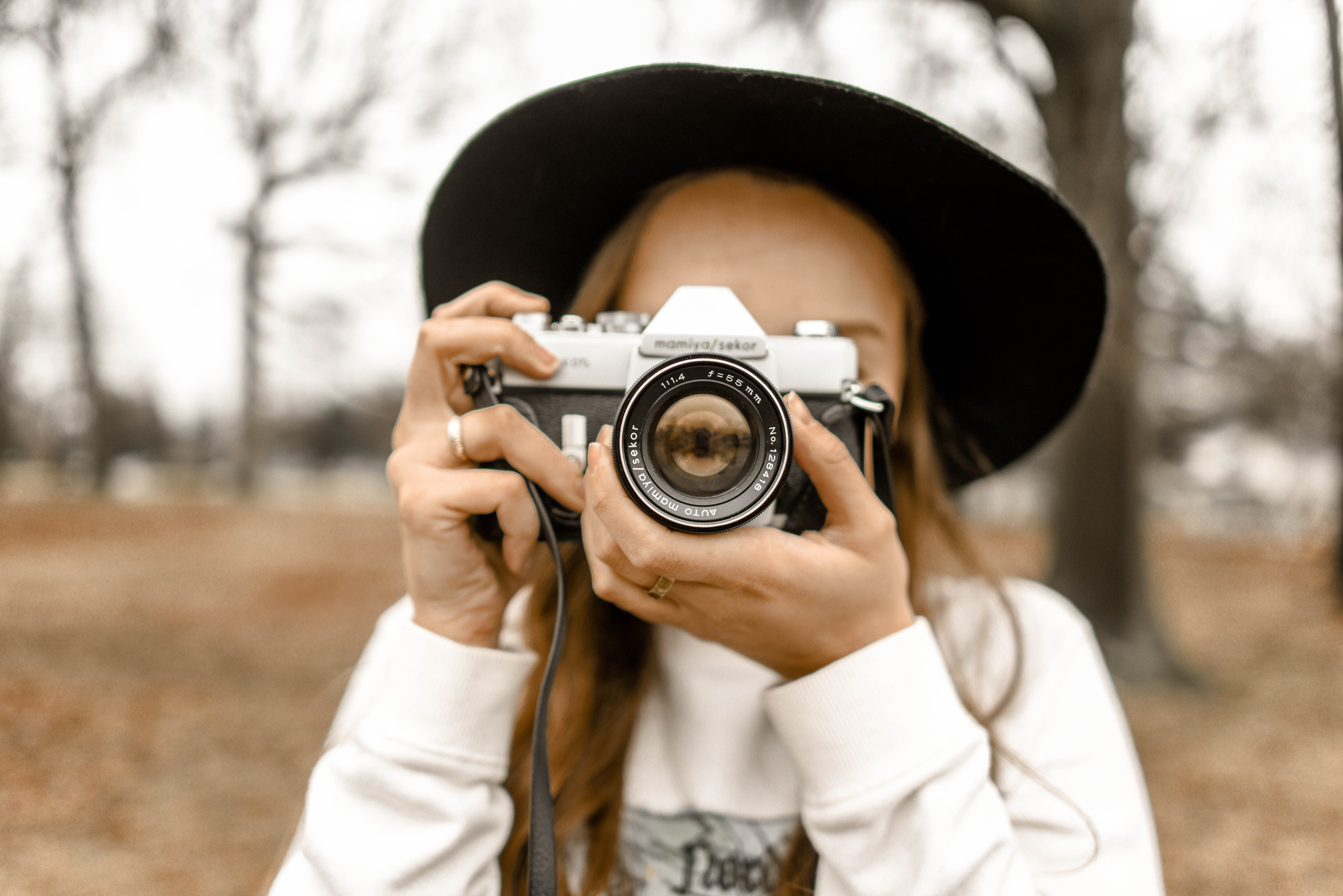 Selective Focus Photography of Woman Using White and Black Slr Camera