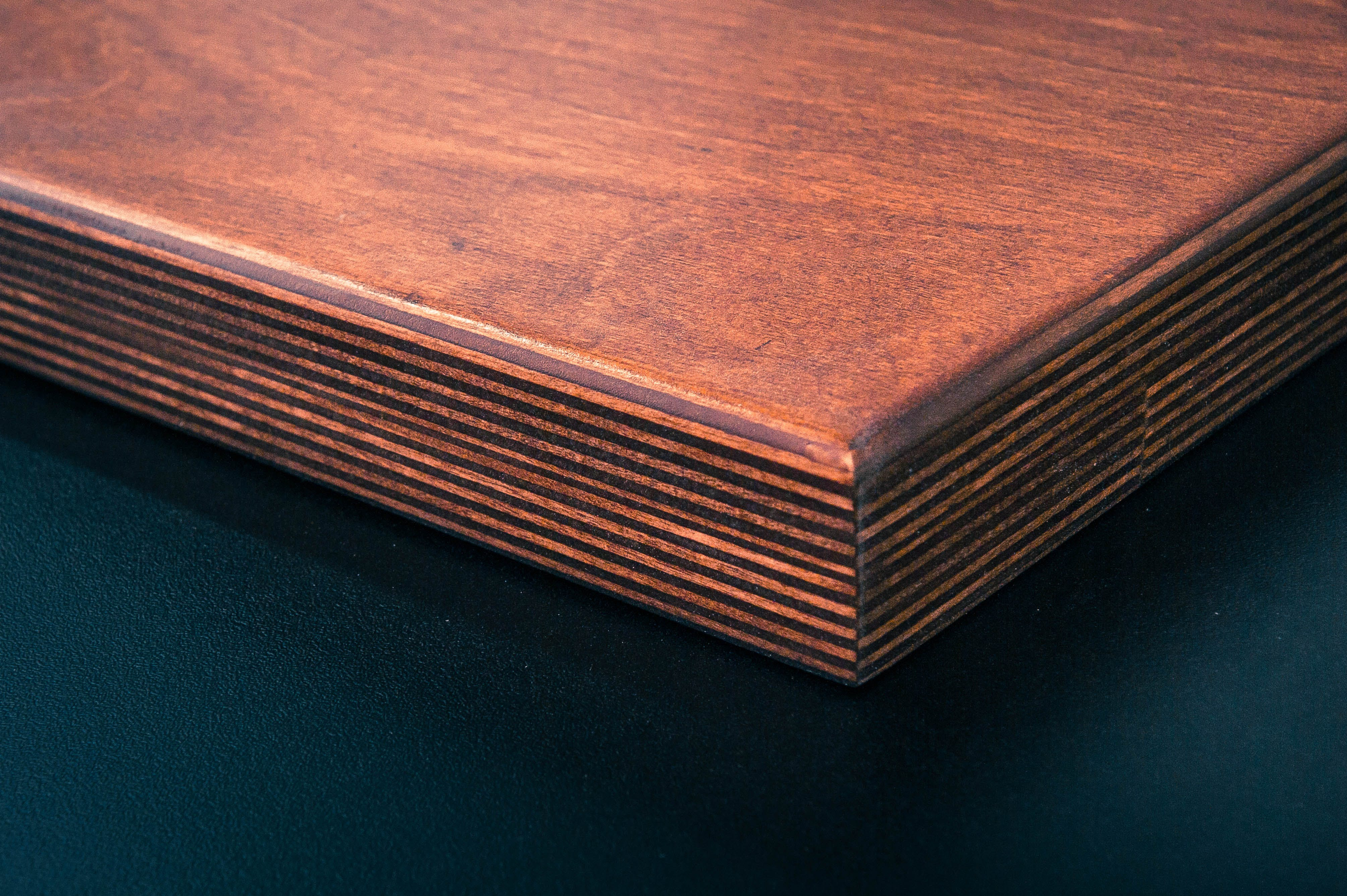 Brown Wooden Board Near Black Surface