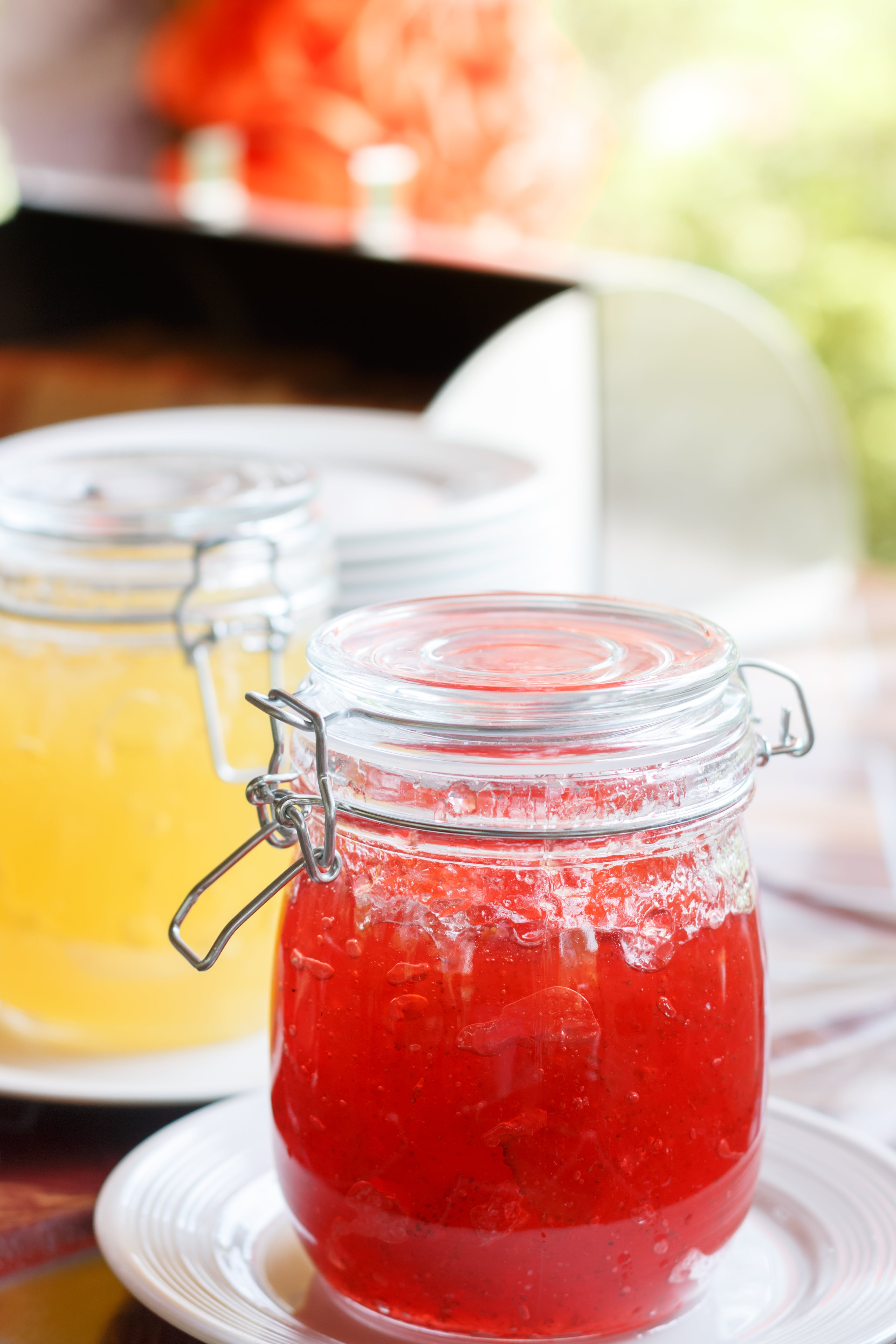 Jar With Red Jam on White Sauer