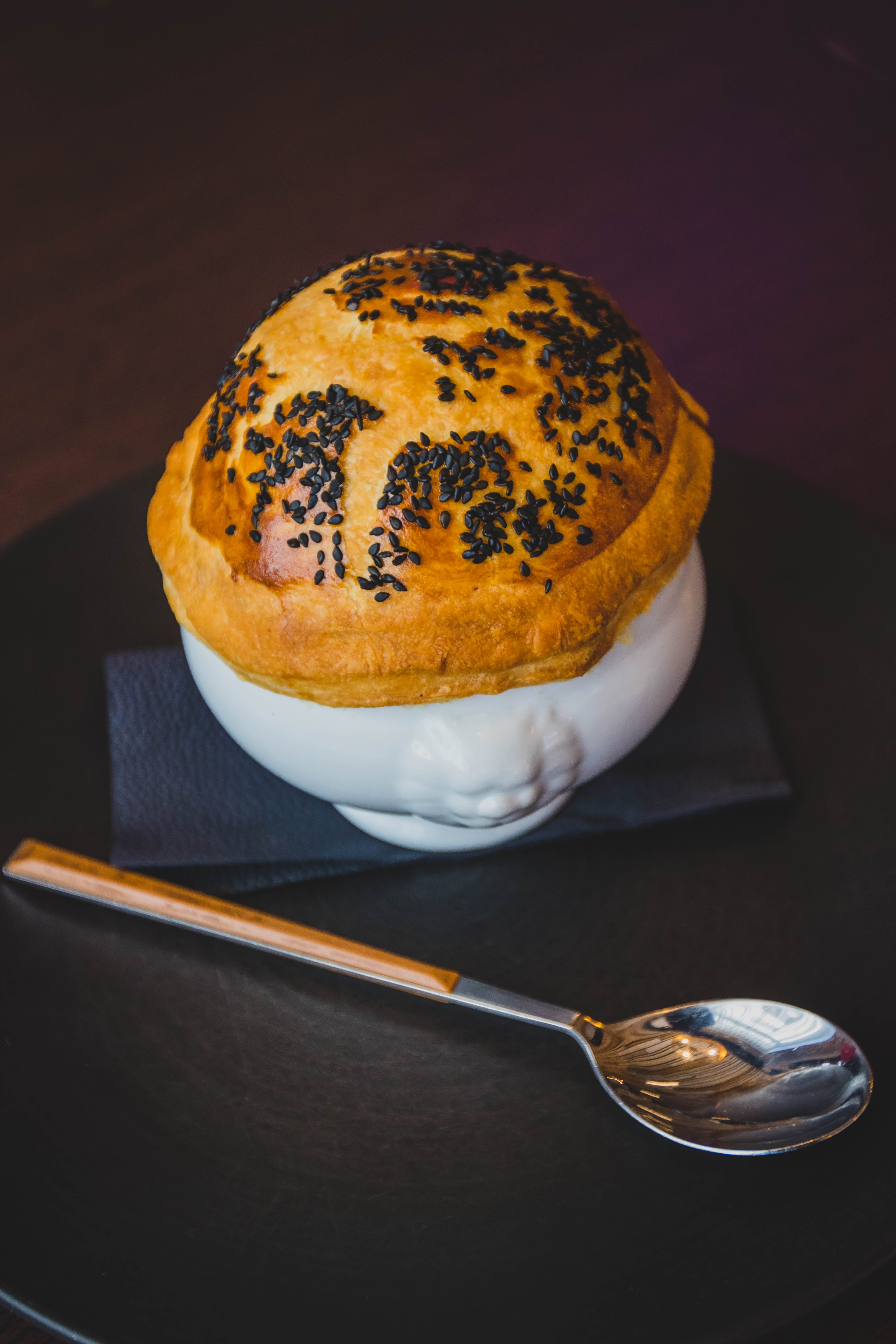Pastry on White Cup Beside Silver Spoon