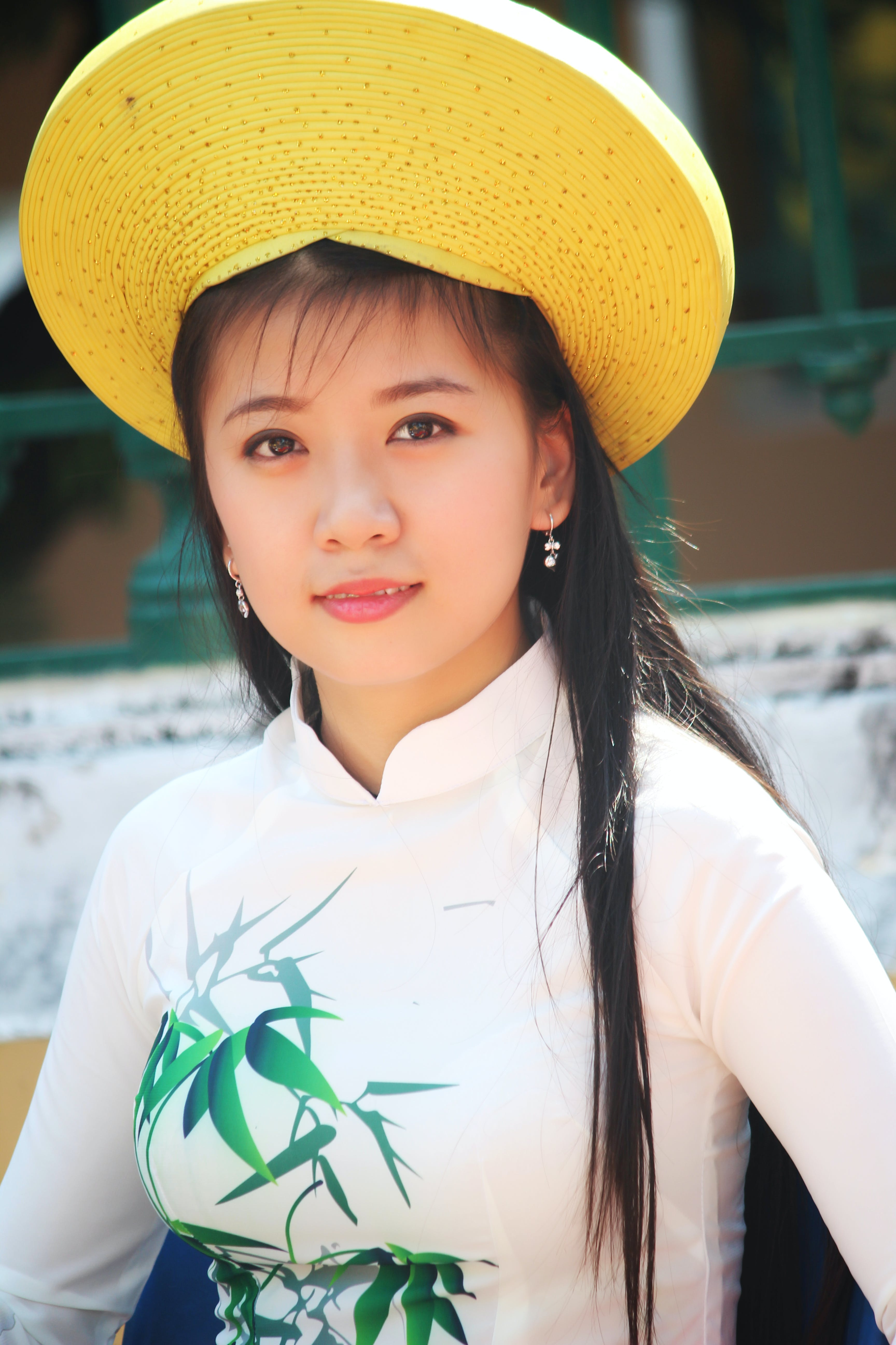 Woman Wearing White Long-sleeved Shirt and Yellow Hat
