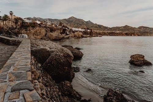 Foto profissional grátis de água, aldeia, areia, beira-mar