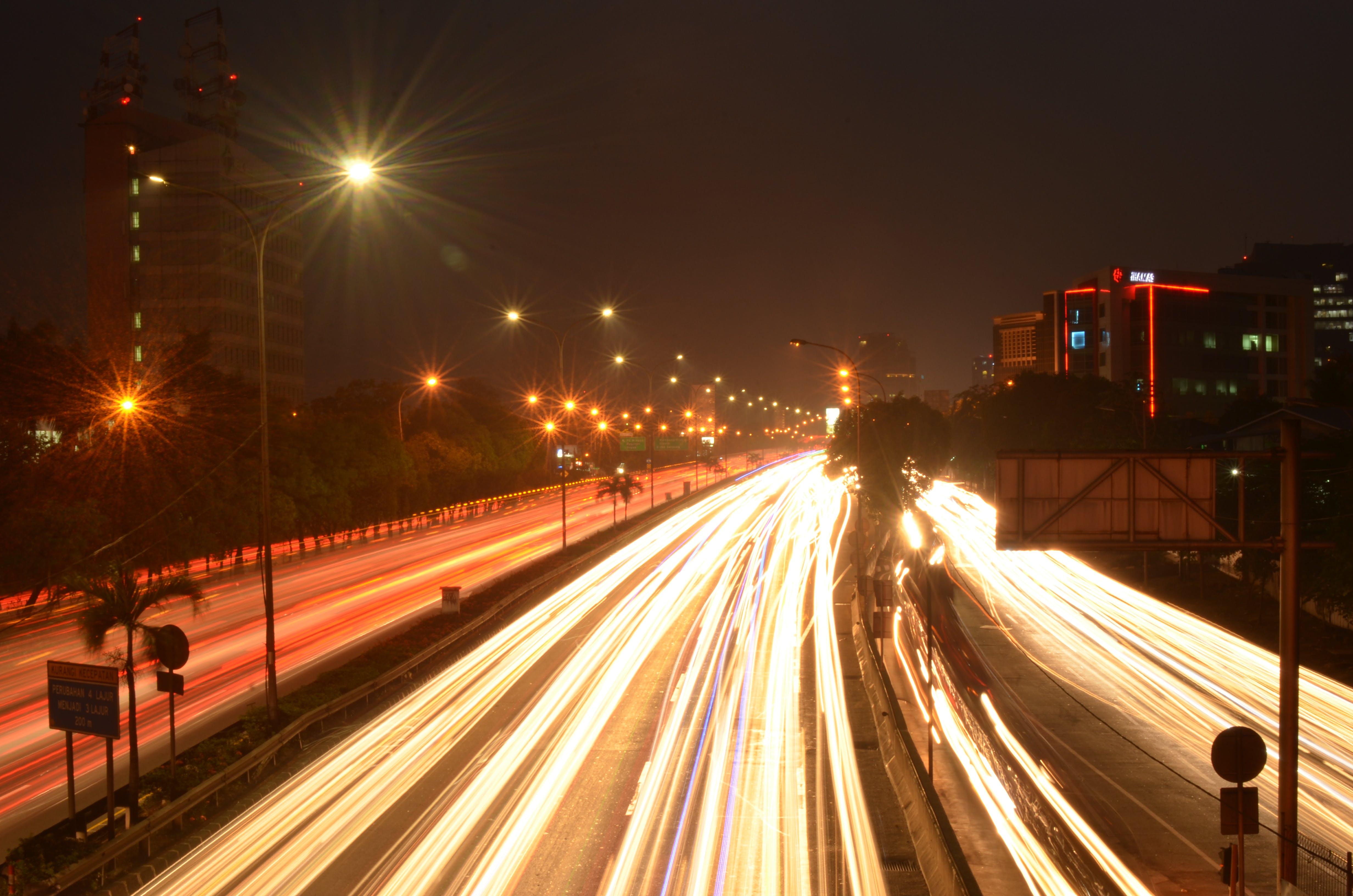 Free stock photo of building, car lights, city lights, lamp