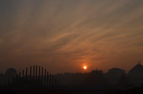 Foto profissional grátis de fotografia, fotografia noturna, luz de fundo, nuvens
