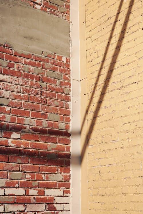 Brick walls in bright sunlight