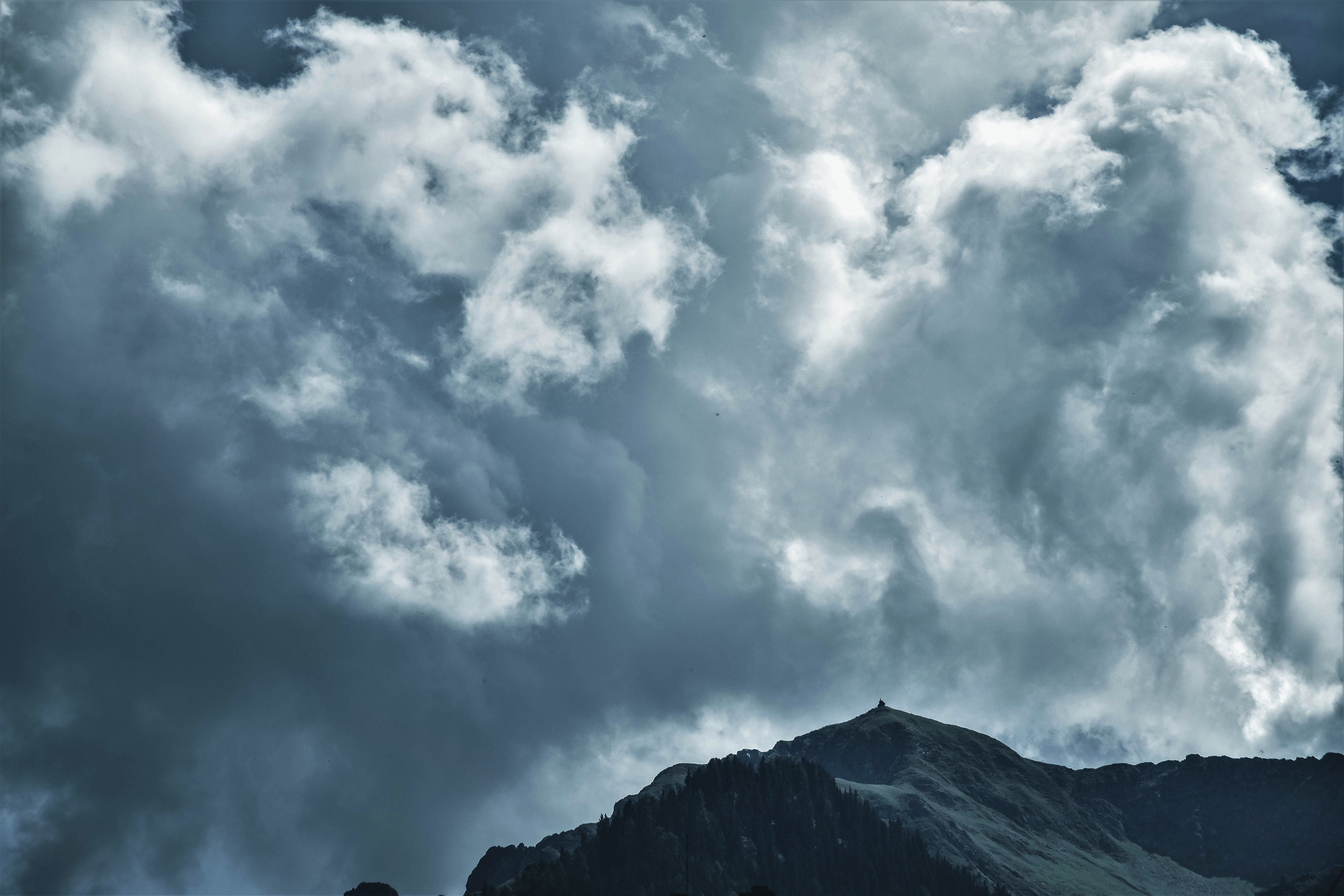 Photo of Cloudy Sky Under Mountain