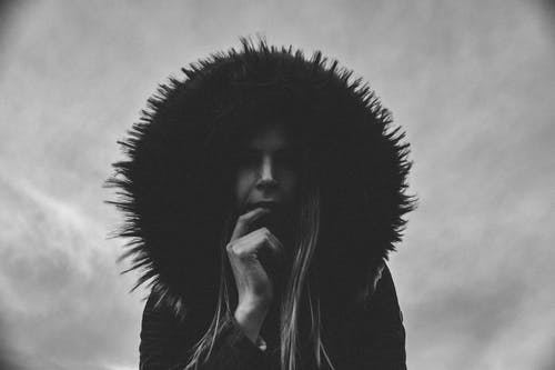 Woman Wearing Hooded Jacket Grayscale Photo