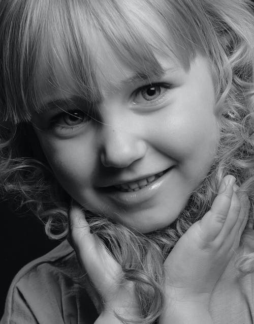 Grayscale Photo of Smiling Girl