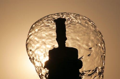 Fotobanka sbezplatnými fotkami na tému vodná fontána späť osvetlená slnkom