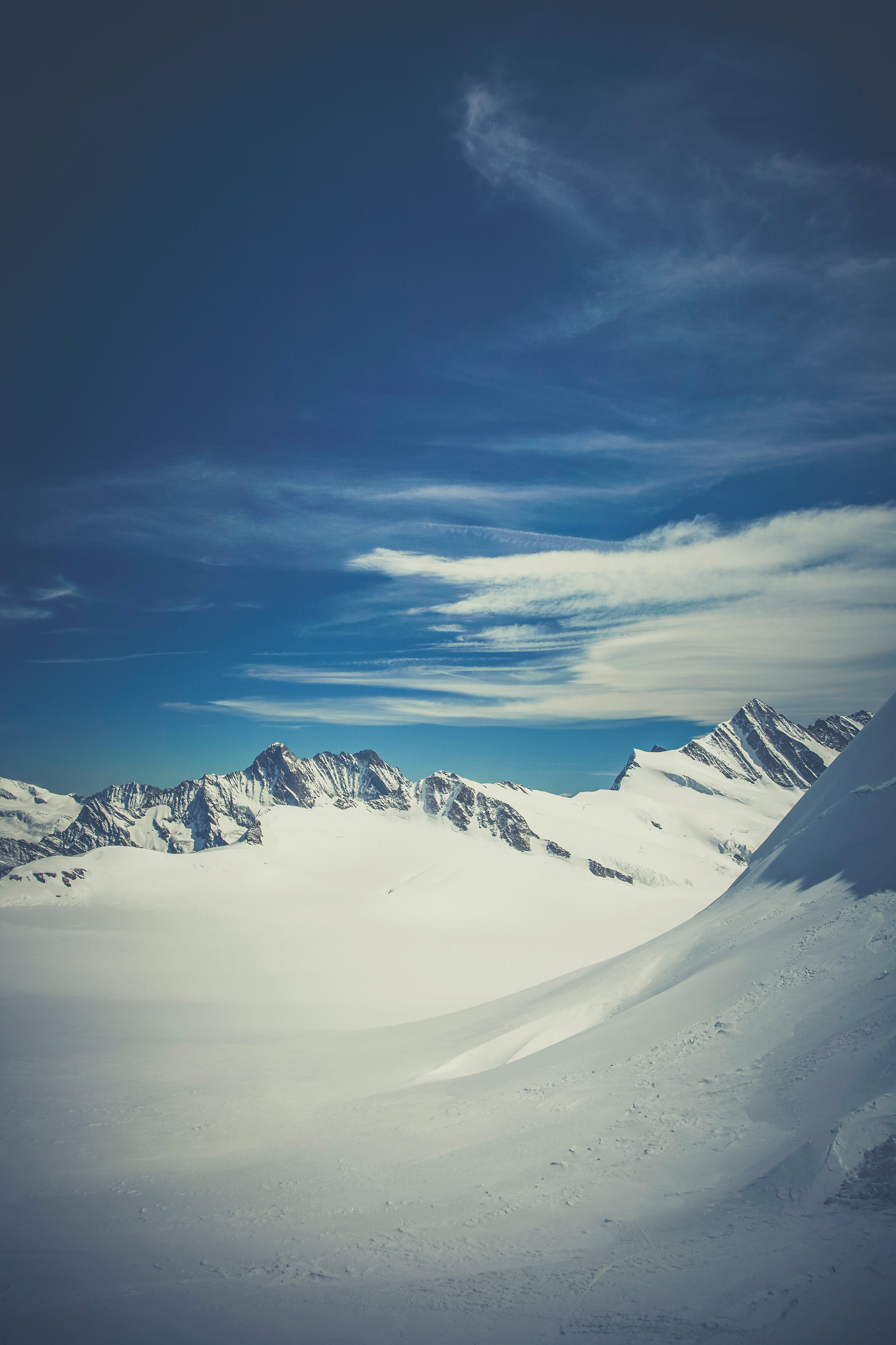 Mountain Surrounded by Snow Under Blue Sky
