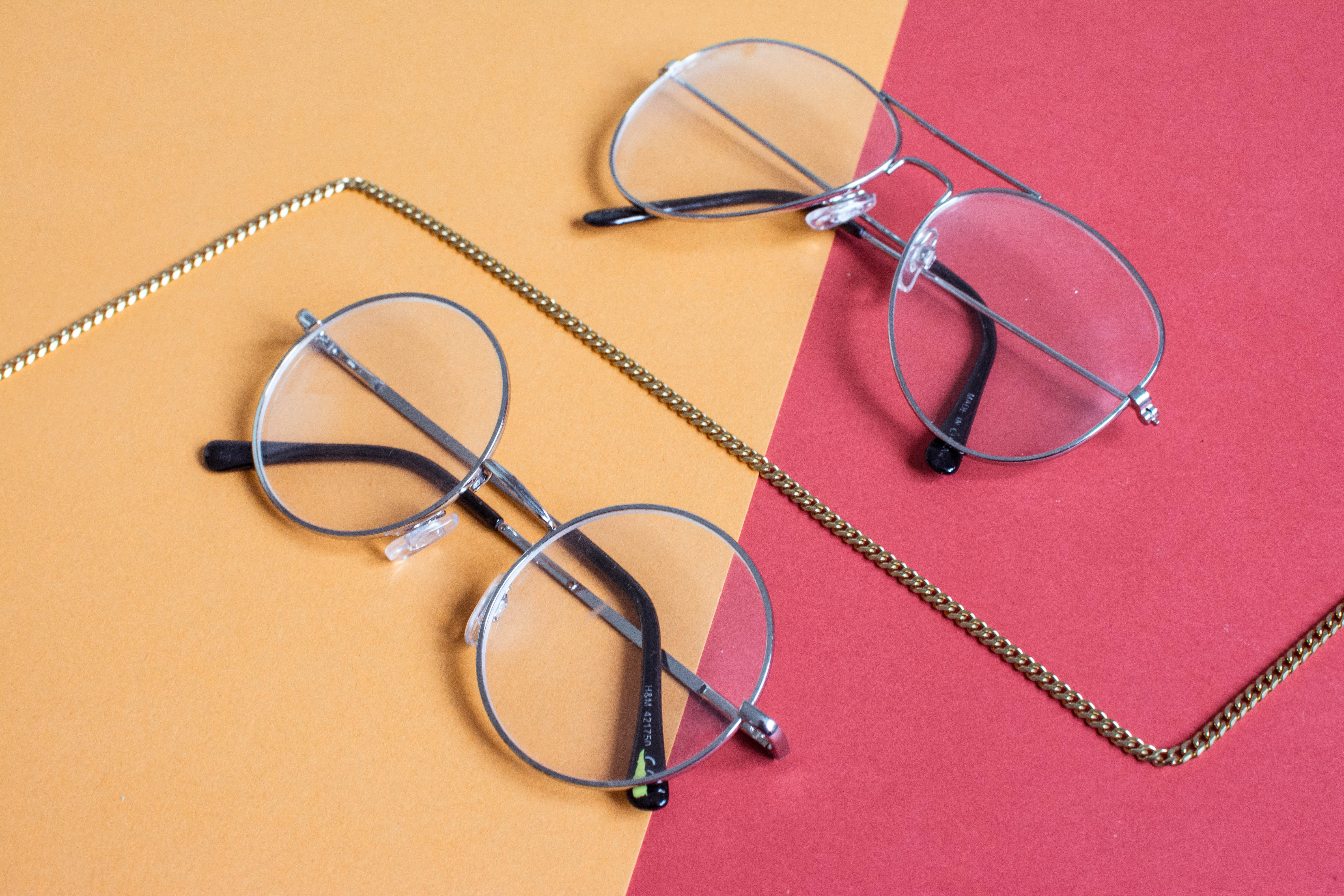Two Clear Aviator Eyeglasses With Gray Steel Frame