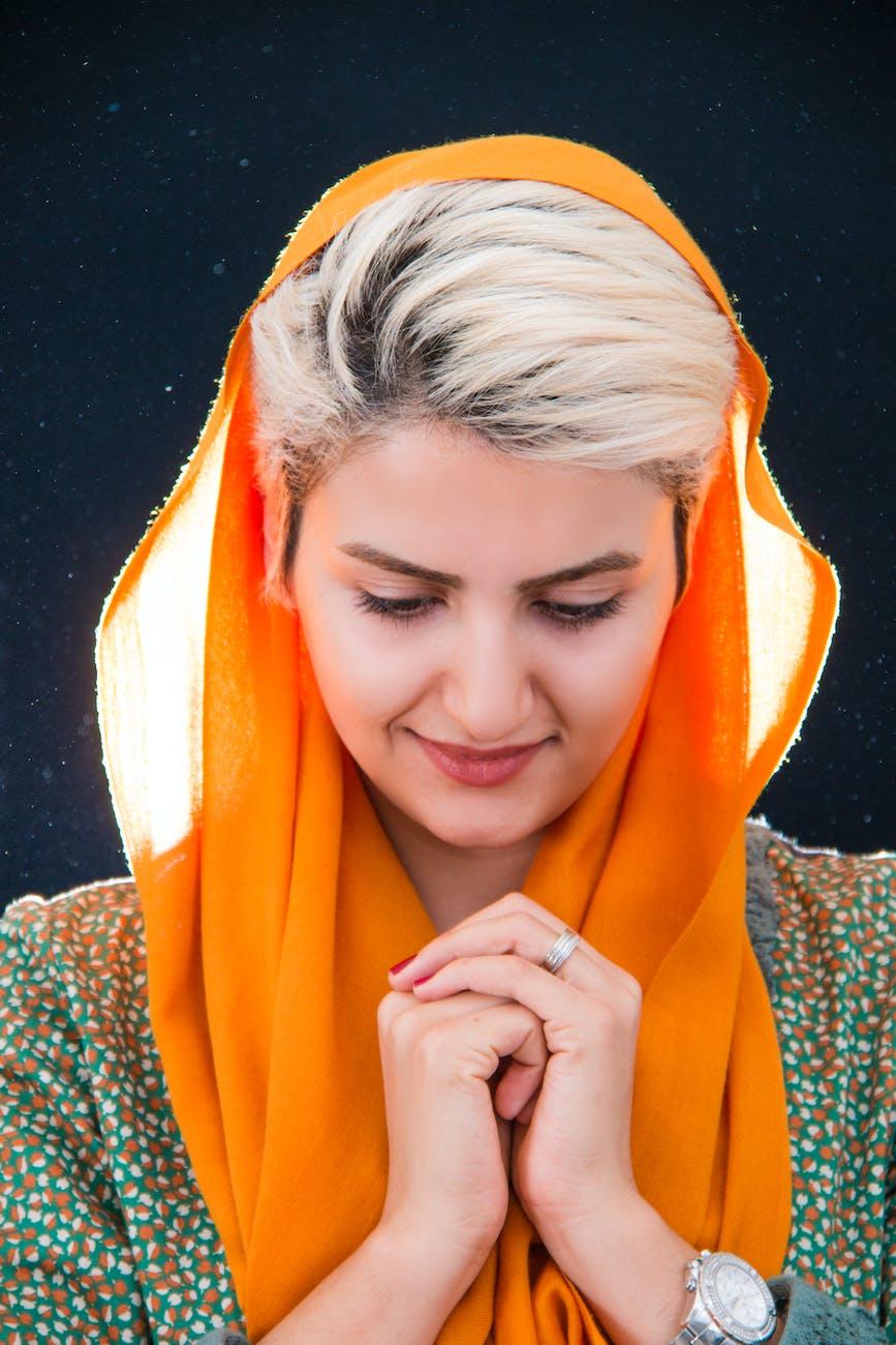 Woman wearing orange hijab headdress